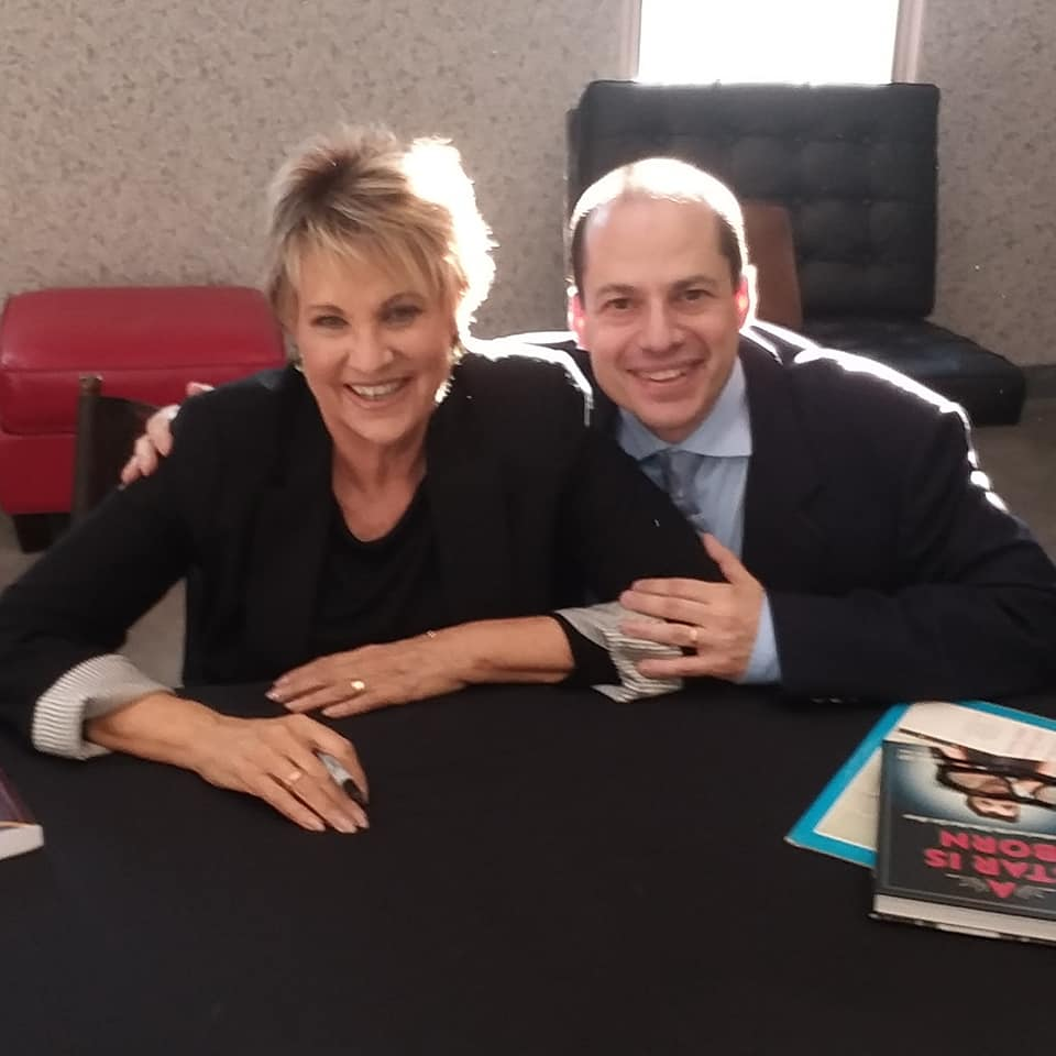 John dileo with lorna luft after her book signing and their onstage chat at the 2018 festival -