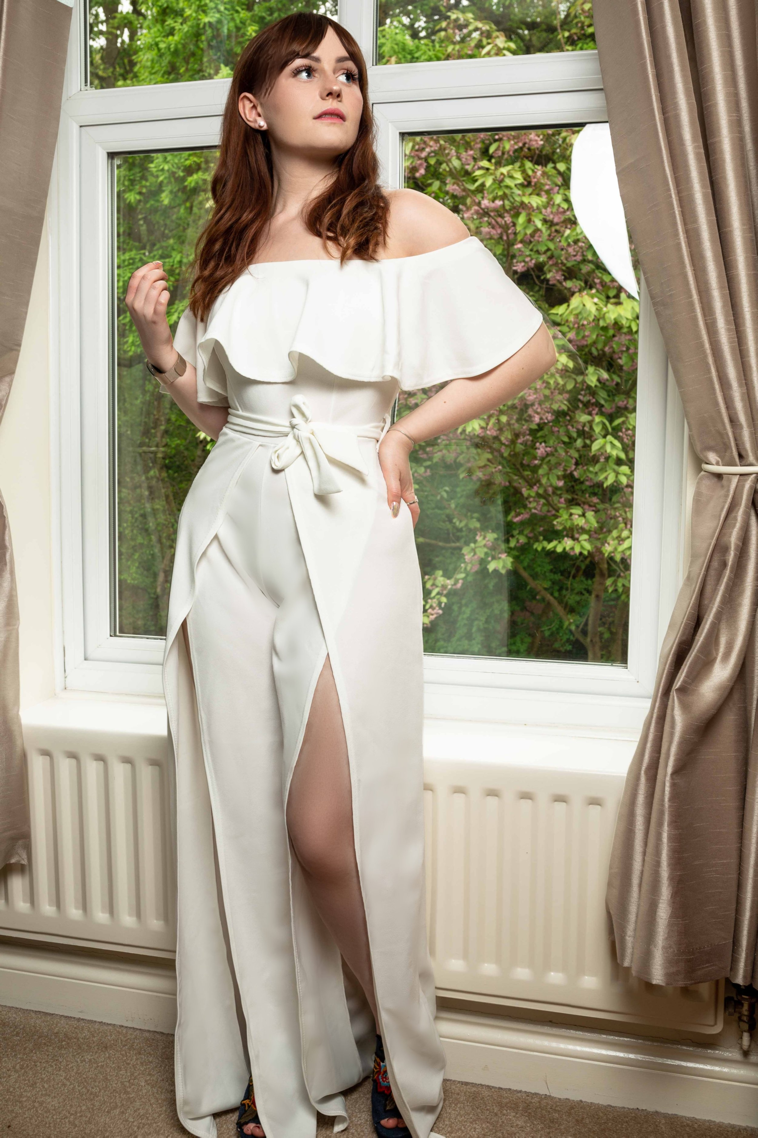 1. - Club L LondonWhite Bardot Frill Detail Split Leg Jumpsuit£45.00This split leg jumpsuit looks great for a summer graduation. Plus, It's guaranteed to be a little bit different to what everyone else is wearing. It's a stretchy crepe material and is really comfortable: perfect for a long day of waiting to take photos. This jumpsuit is great for anyone wishing to create the illusion of longer legs with the added bonus of cinching in the waist. Word of caution - if you're a messy eater, don't wear white!