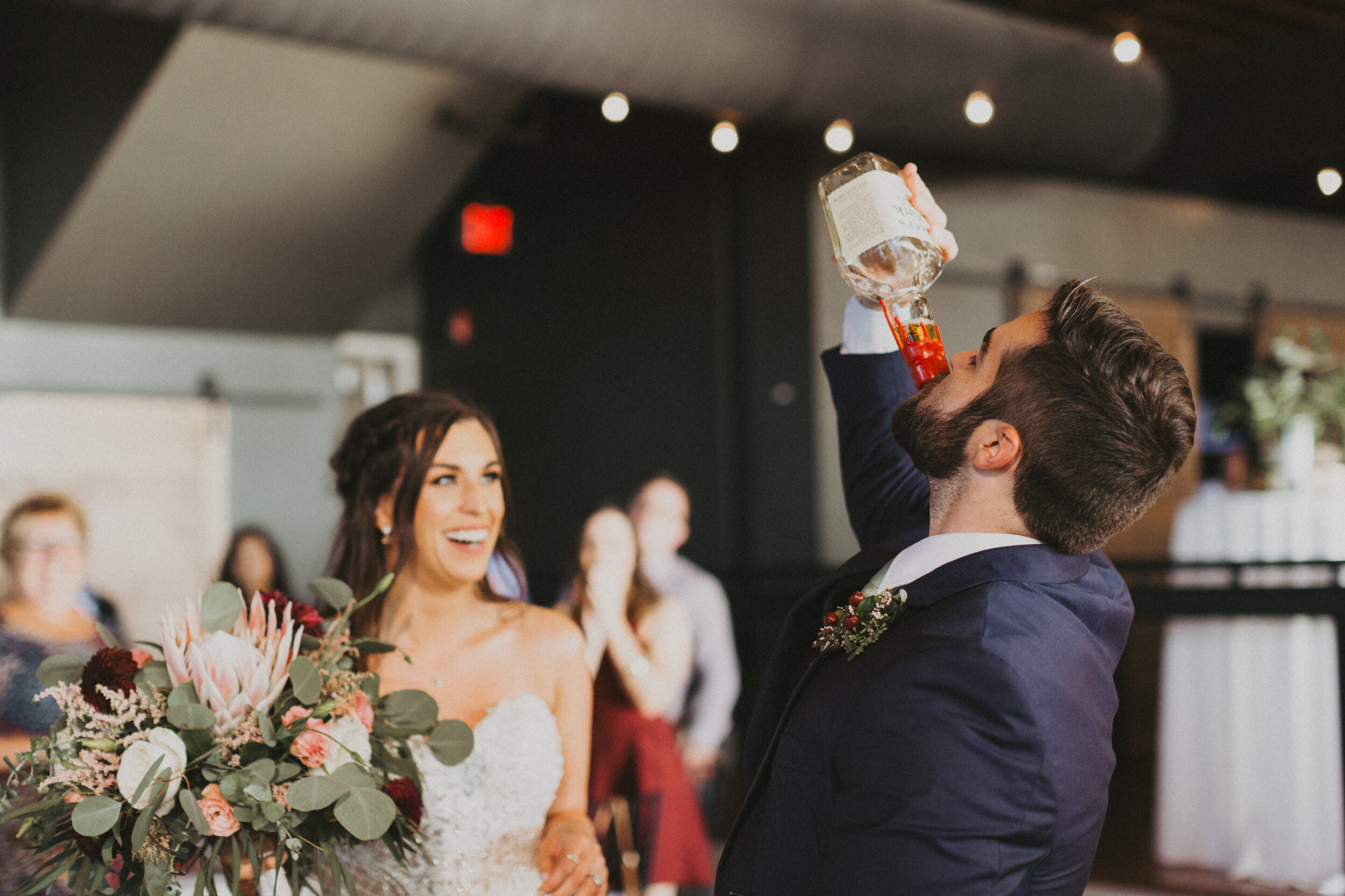 "So for our entrance, for the first time, I shared that bottle with someone. Logan and I both, in a very ""us"" way, took pulls from his bottle as our entrance to the reception. Those who knew about the bottle obviously loved it, and those who didn't loved it because it was just so us!"