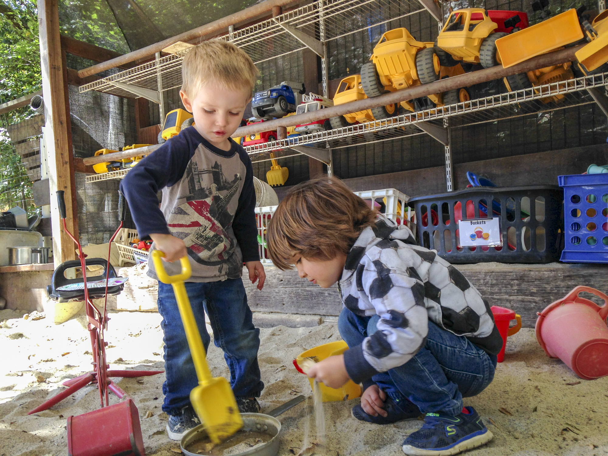 THE MAIN YARD - With lots of room to run and play and new hands-on activities set up daily, children are in the main yard rain or shine.Here you'll find seemingly limitless opportunities for play, including a climbing wall, water table, and a giant covered sandbox.