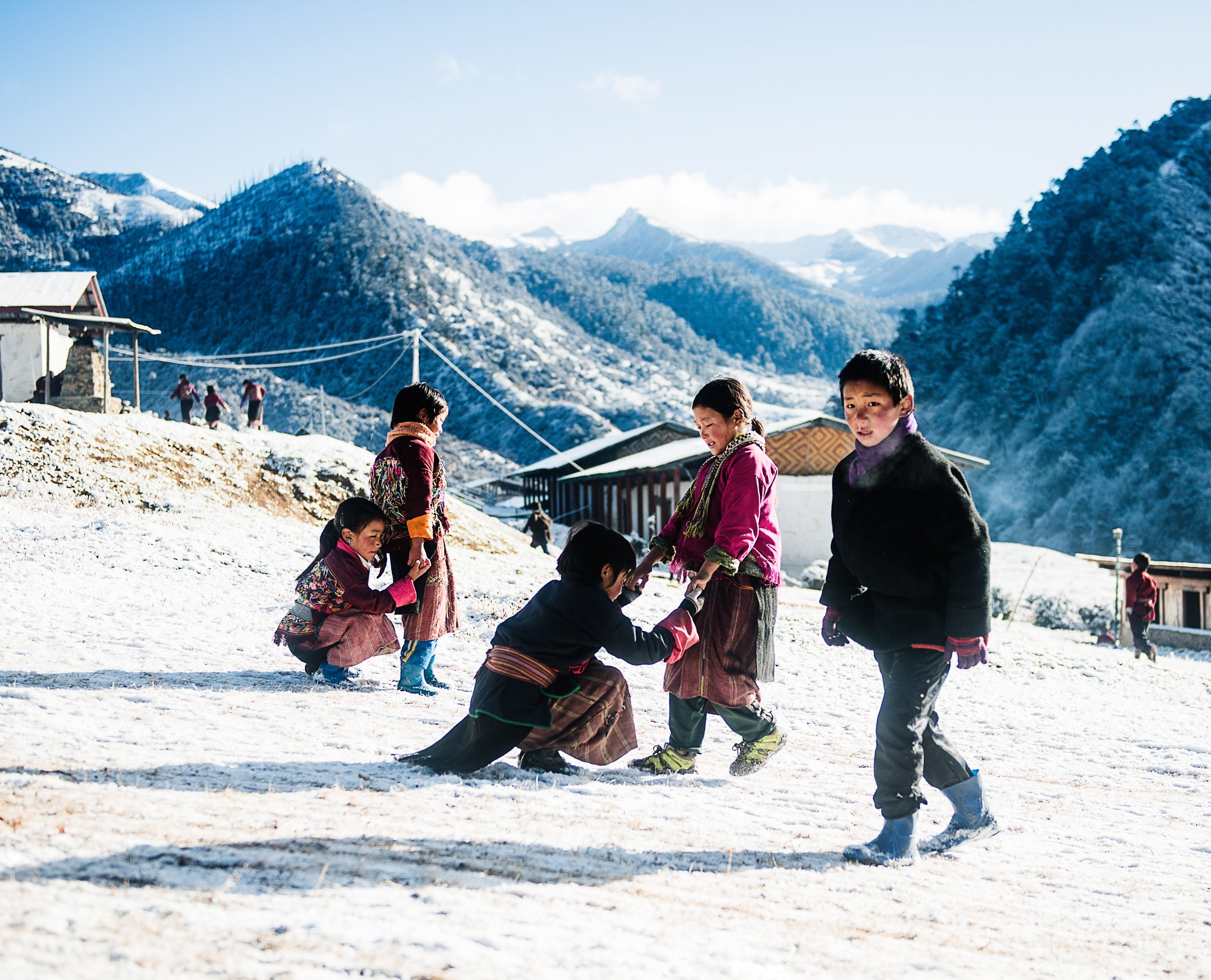 Children enjoying the recent snowfall in Merak village