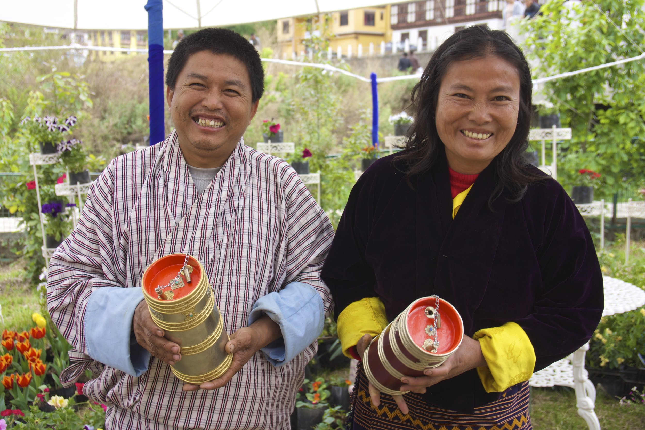 Sangay Tsewang and Tsering Yangzom from Mongar holding ara containers.