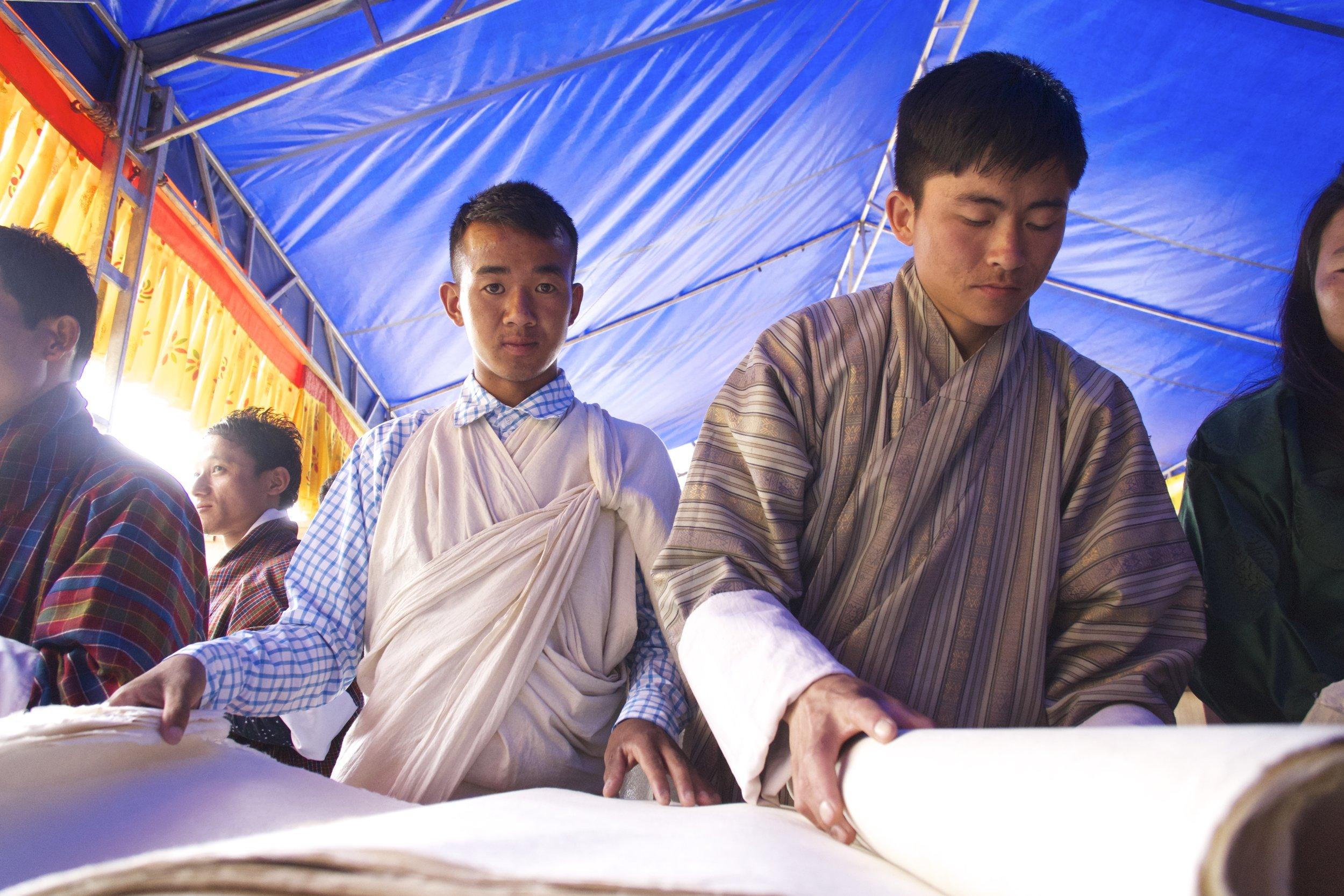 Namgay Tsering and Bepo from Samtse organizing traditional paper
