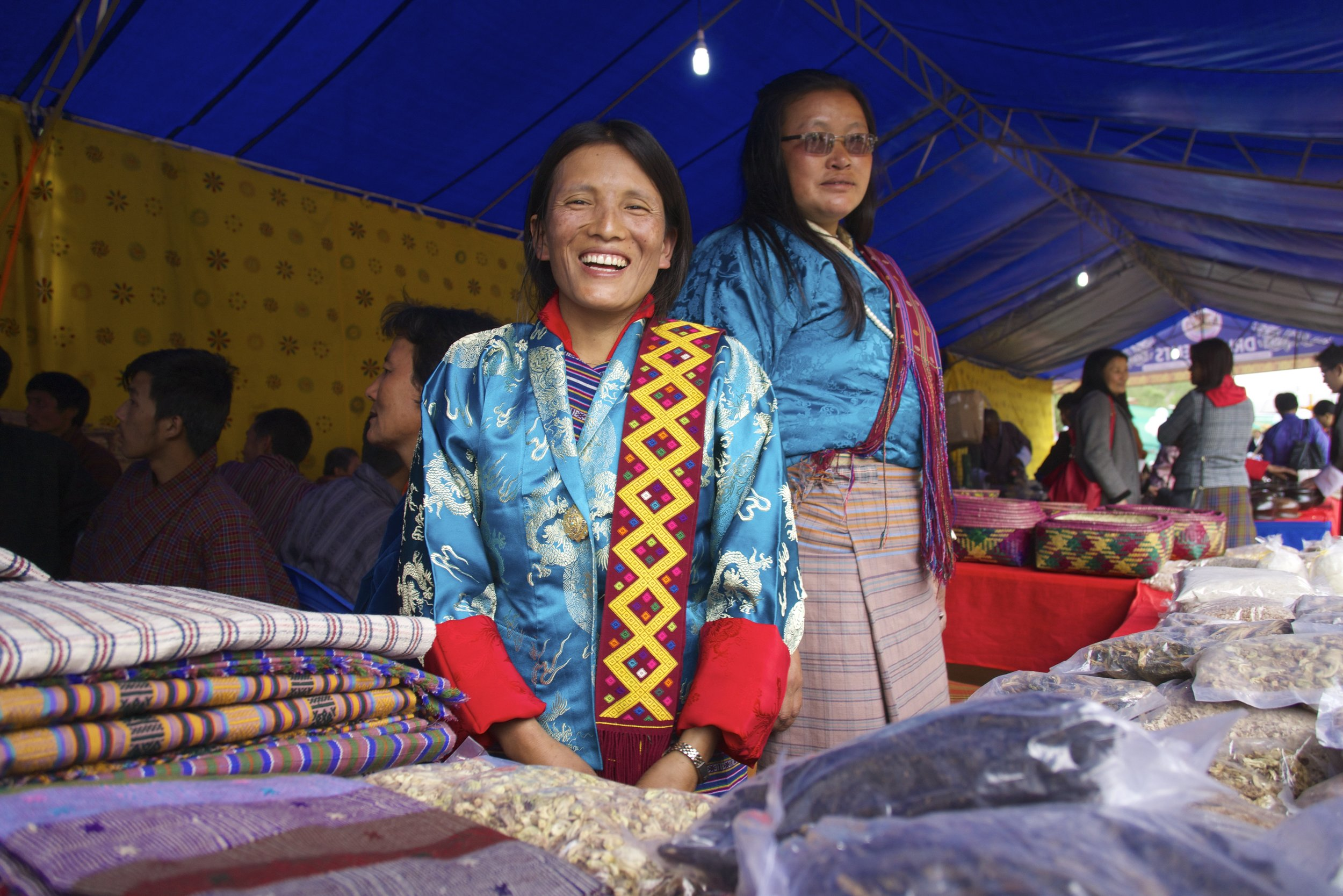 Rinzing Lhamo smiles in front of the goods that she carried to Thimphu from Pemagatshel