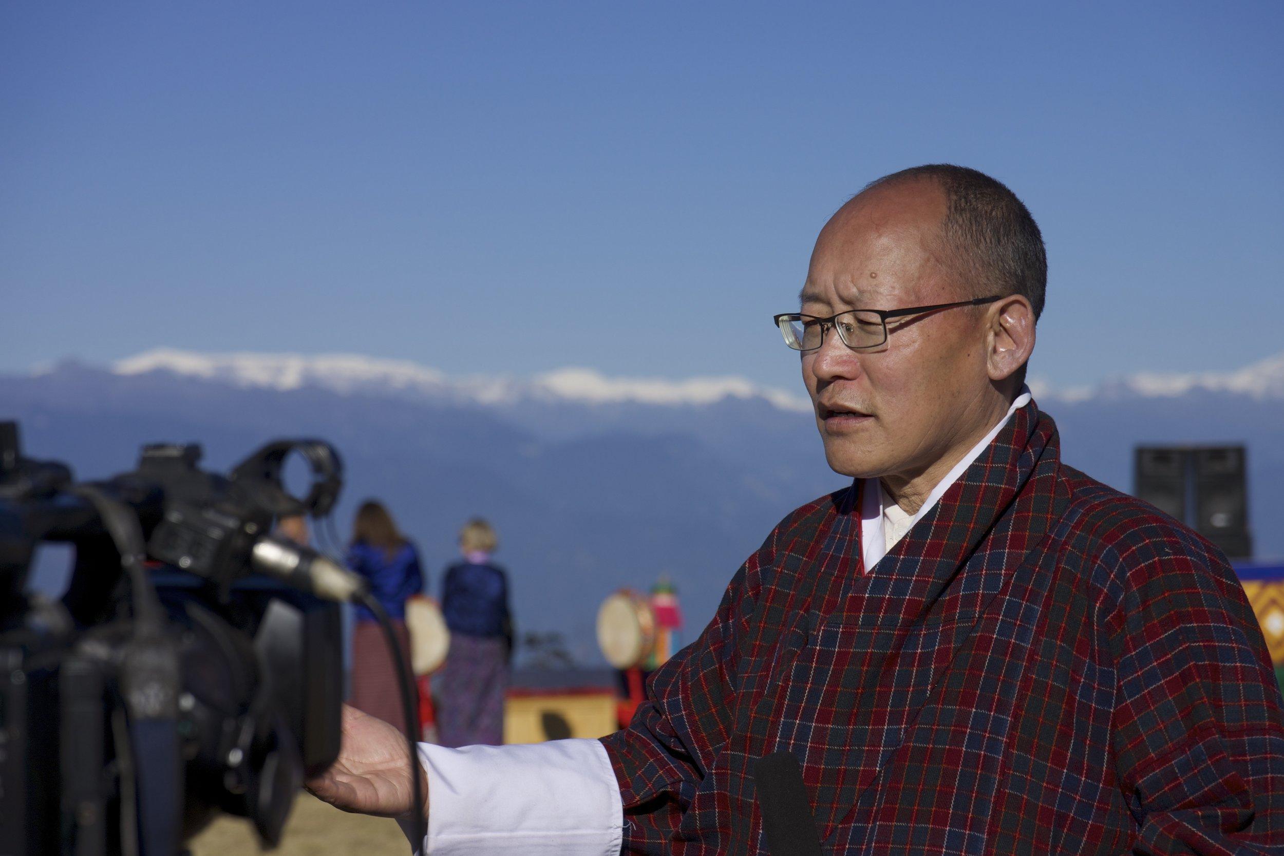 Dr. Karma Ura taking an interview after the Druk Wangyel Tsechu