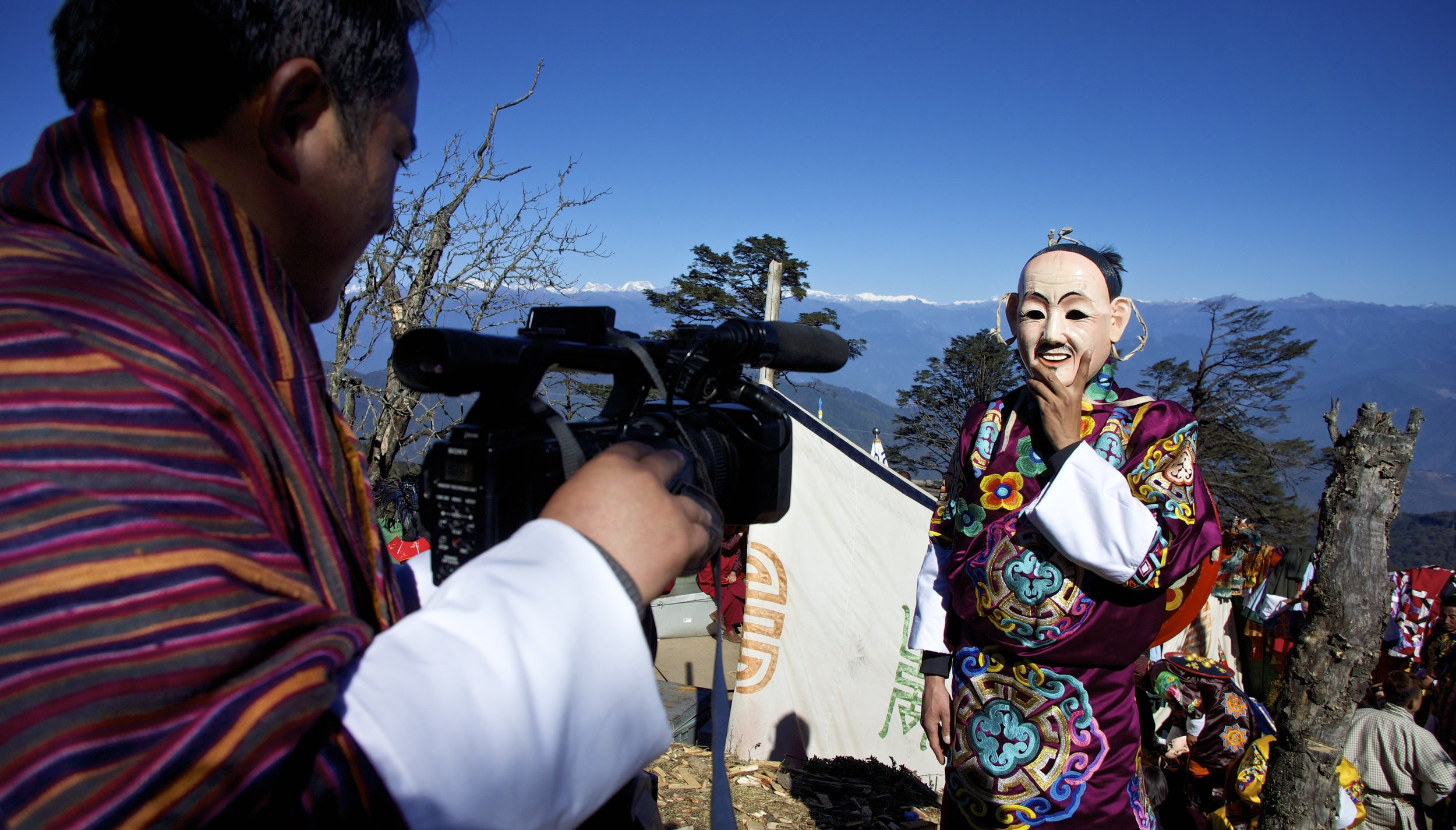 Royal Office of Media Photographer, Jamyang, helps MyBhutan during a shoot at Druk Wangyel Tsechu.