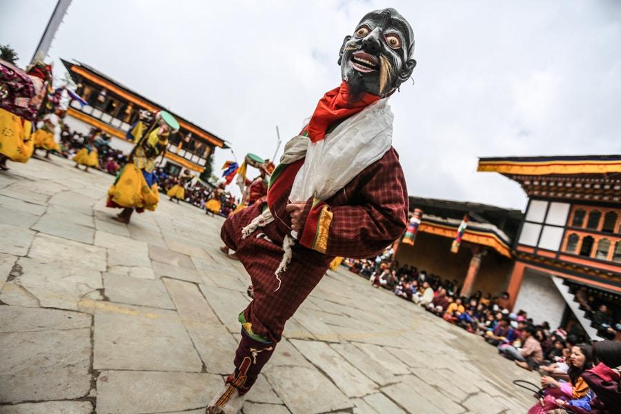 Humorous blessing at Padtsheling Tsechu, Bumthang