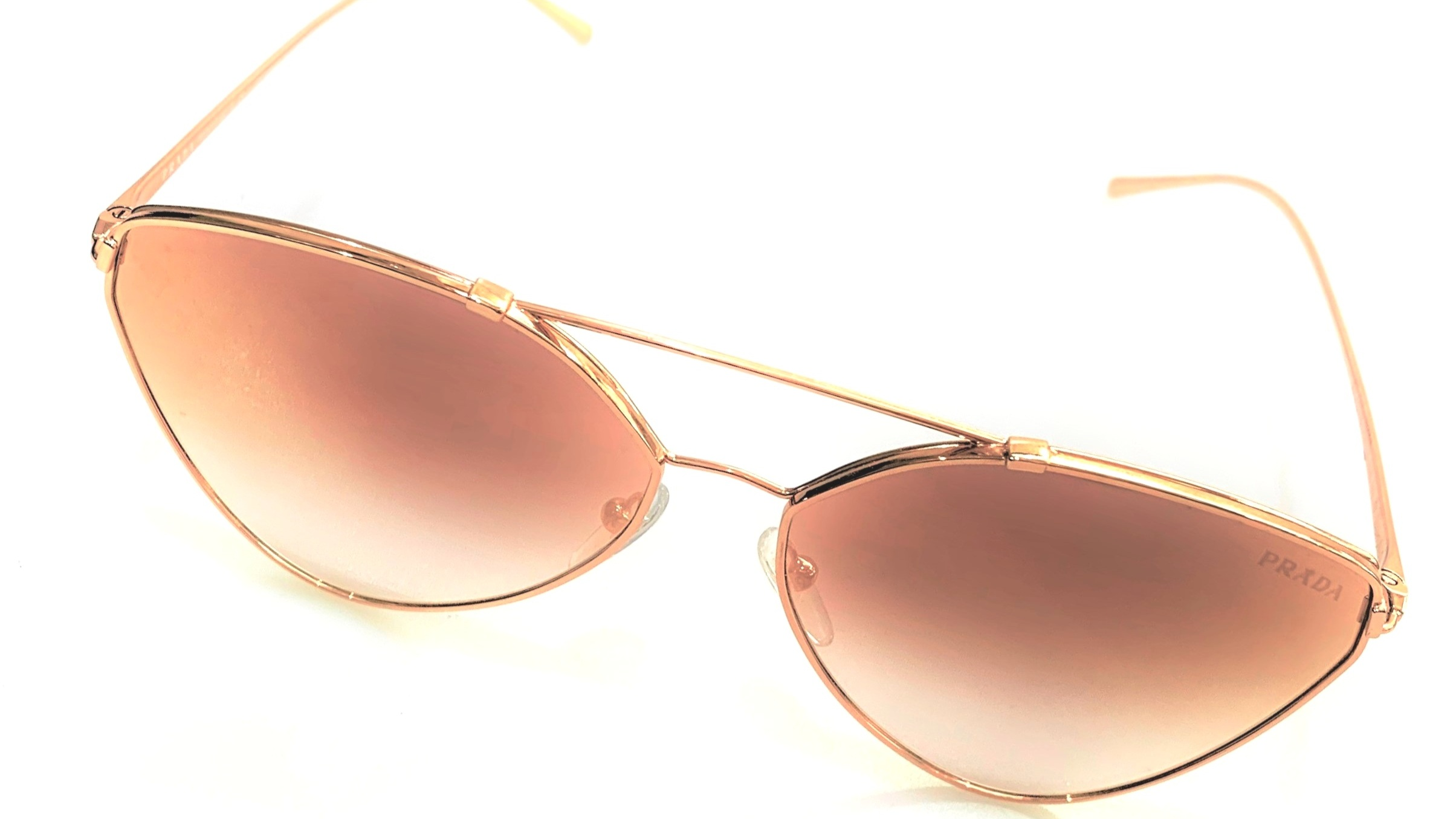 Perfect in Prada - These rose gold Prada mirrored sunglasses are perfect for those who want to add a feminine touch to their festival outfit.