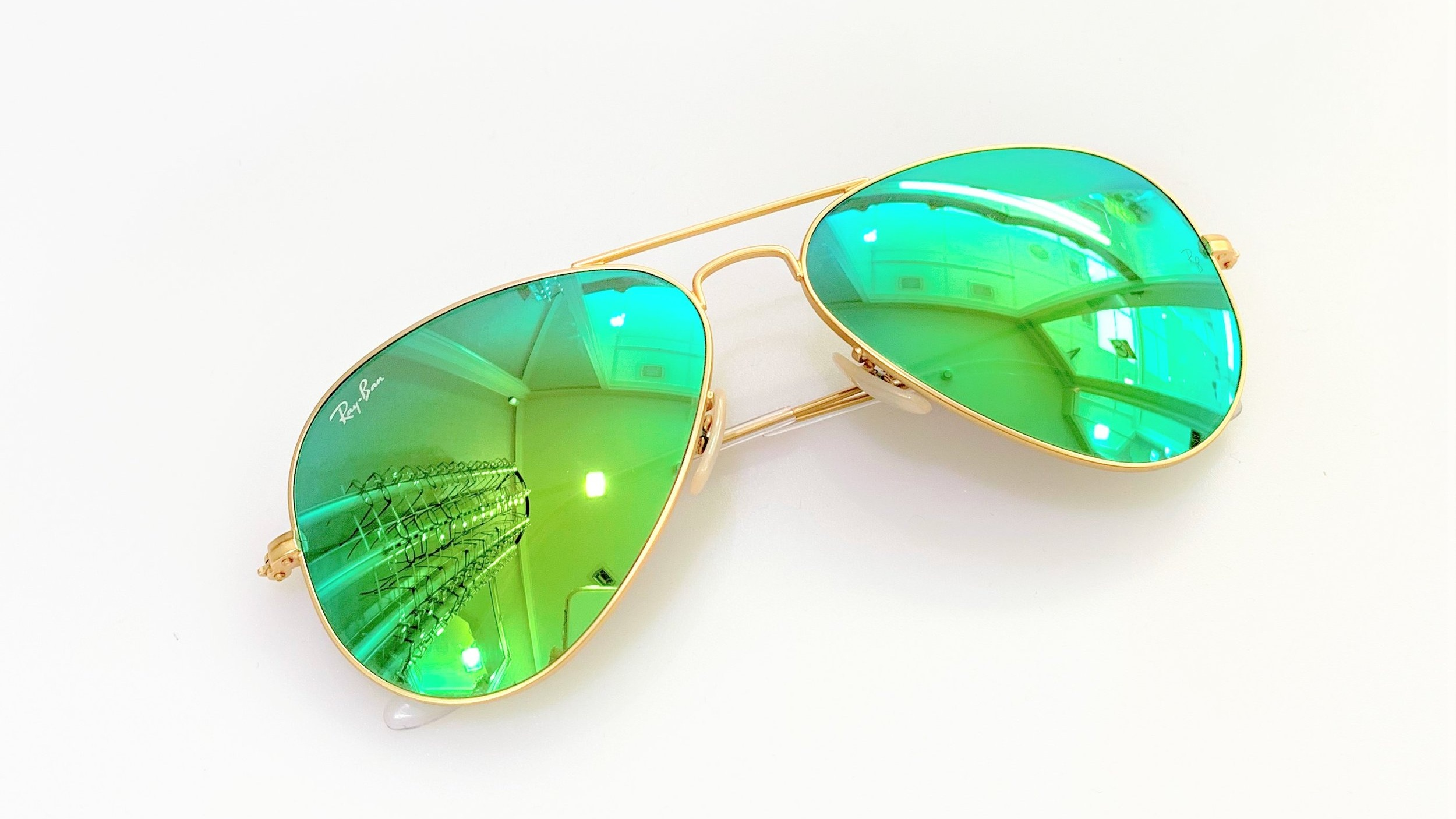 Gorgeous in Green - These green Ray-Ban aviators are bound to make you stand out from the rest of the crowd at the festivals this summer.