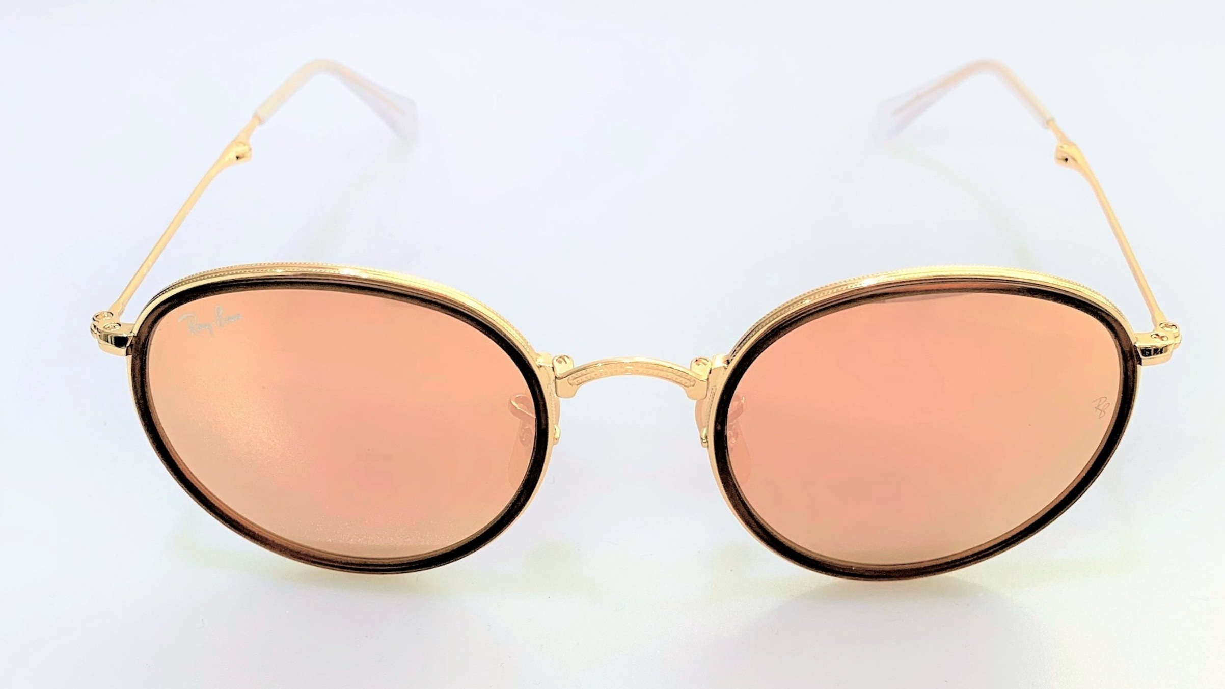 Rosy in Ray-Ban - These rose gold Ray-Ban sunglasses not only look great but are super practical too as they fold up.. perfect to pop in your pocket or bag when the sun sets.