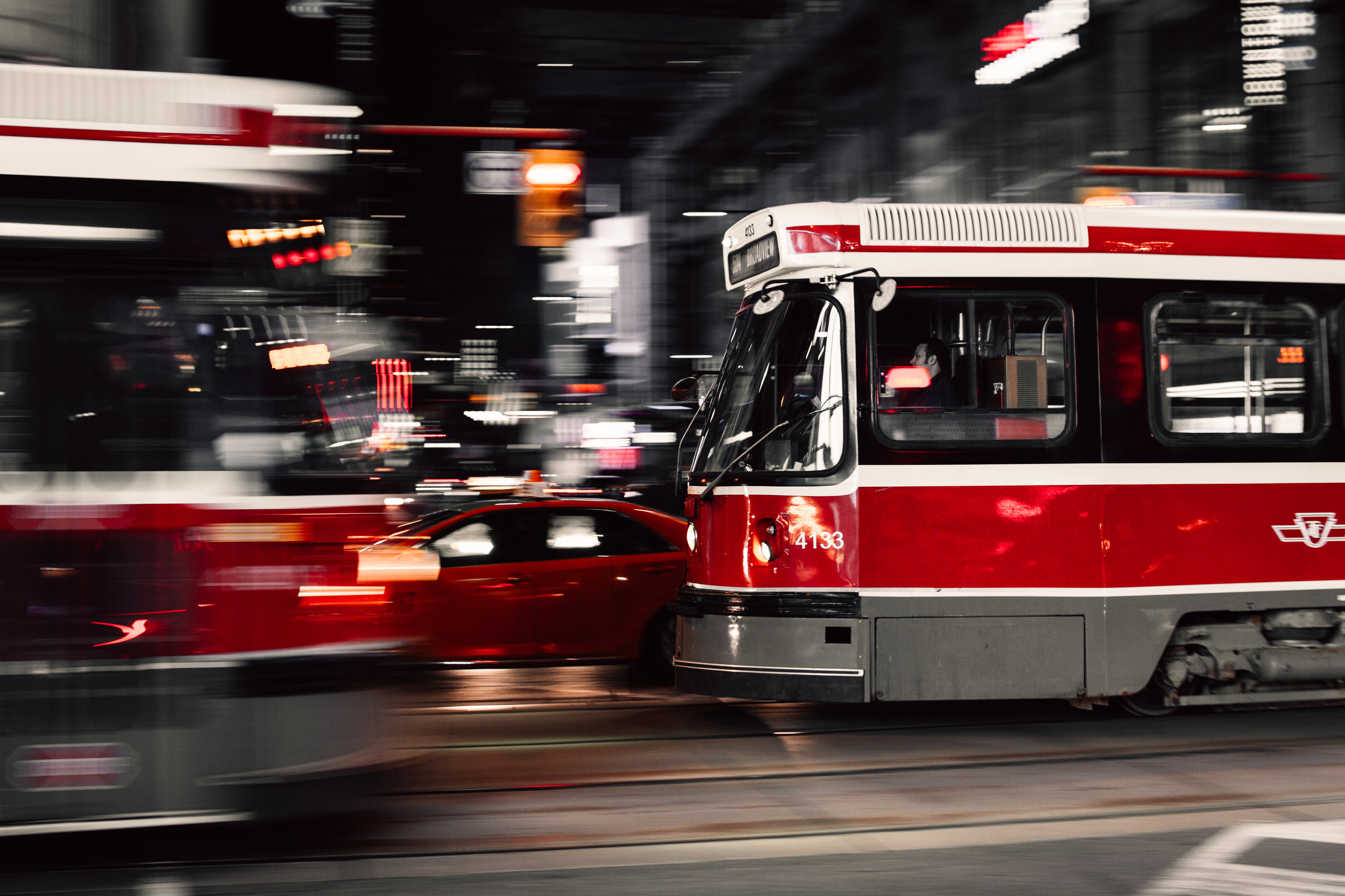 Photo of streetcars in Toronto, nighttime. Photo courtesy of Unsplash