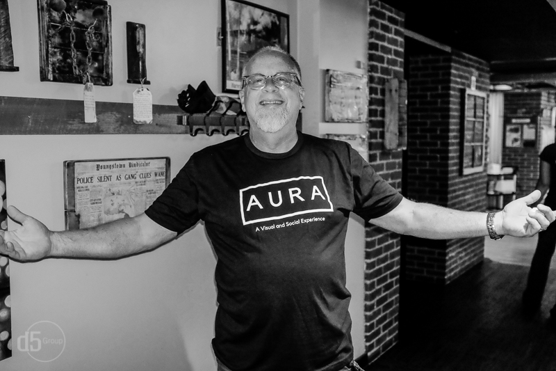 Co-owner of the Speakeasy Lounge wearing an AURA designer T-shirt.