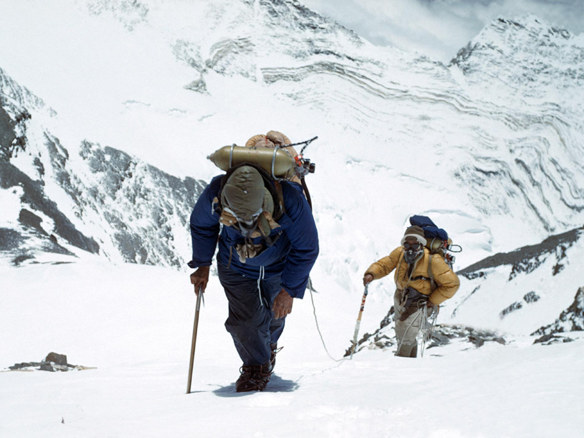 Edmund Hillary & Tenzing Norgay summiting Mount Everest for the first time.