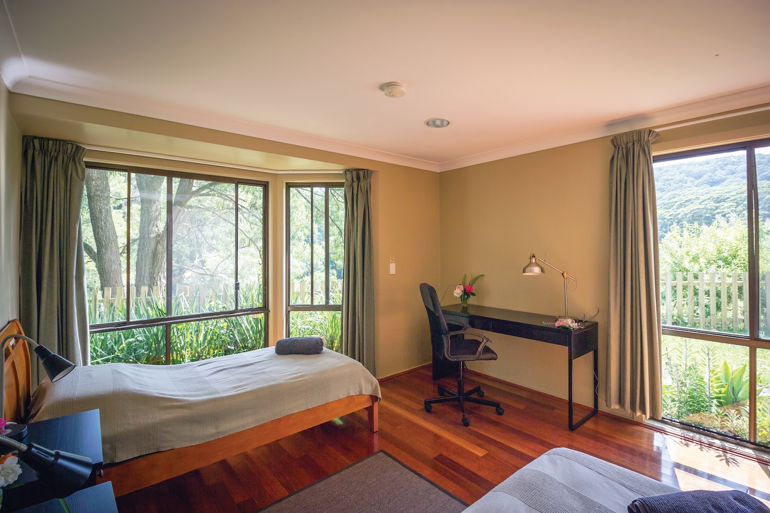 PACKAGE 1 - TWIN ROOM W/ ENSUITE Features: Private Bathroom, 2 x Single Beds, polished wooden floors, fans + heater, free high speed WiFi, free parking. Access to all yoga classes + 3 vegan meals daily + workshops.