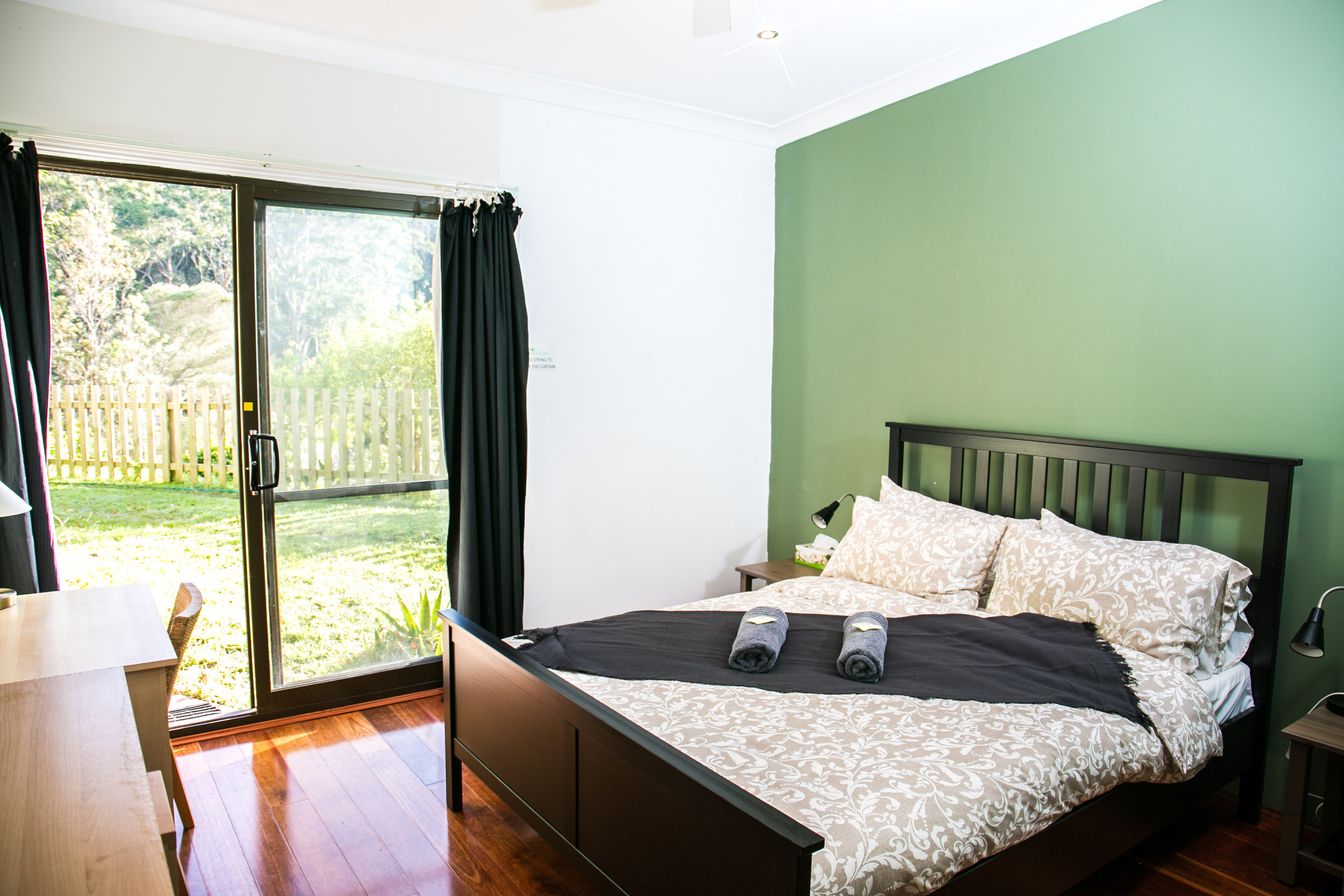 PACKAGE 2 - QUEEN BED + SINGLE BED W/ ENSUITE Features: Private Bathroom, Queen Size Bed + Single bed, polished wooden floors, fans + heater, free high speed WiFi, free parking. Access to all yoga classes + 3 vegan meals daily + workshops.