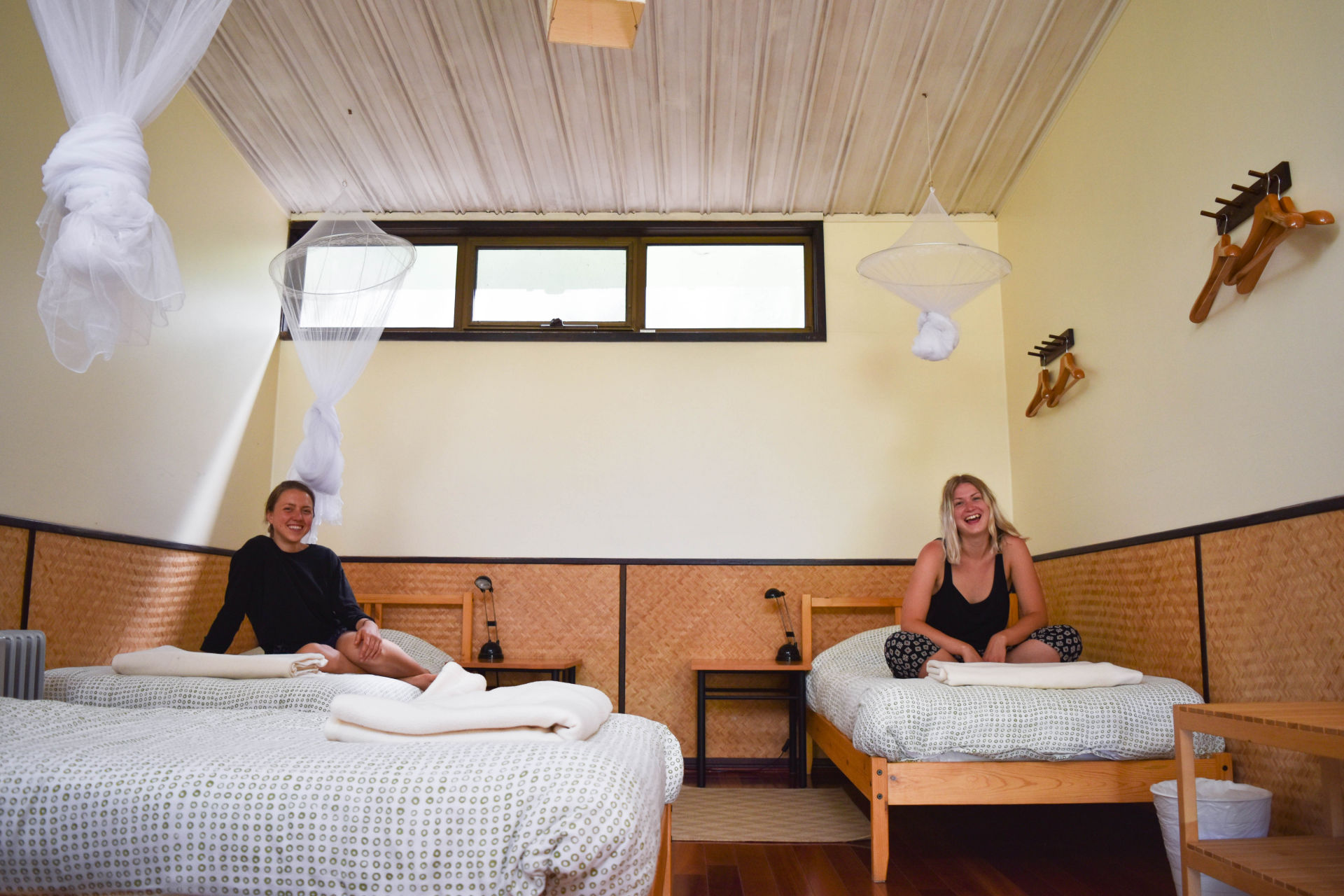 PACKAGE 4 - DORMITORY W/SHARED FACILITIES Features: 4 x Single Beds, communal bathrooms, polished wooden floors, fans + heater, free high speed WiFi, free parking. Incl. yoga classes + 3 vegan meals daily + workshops.