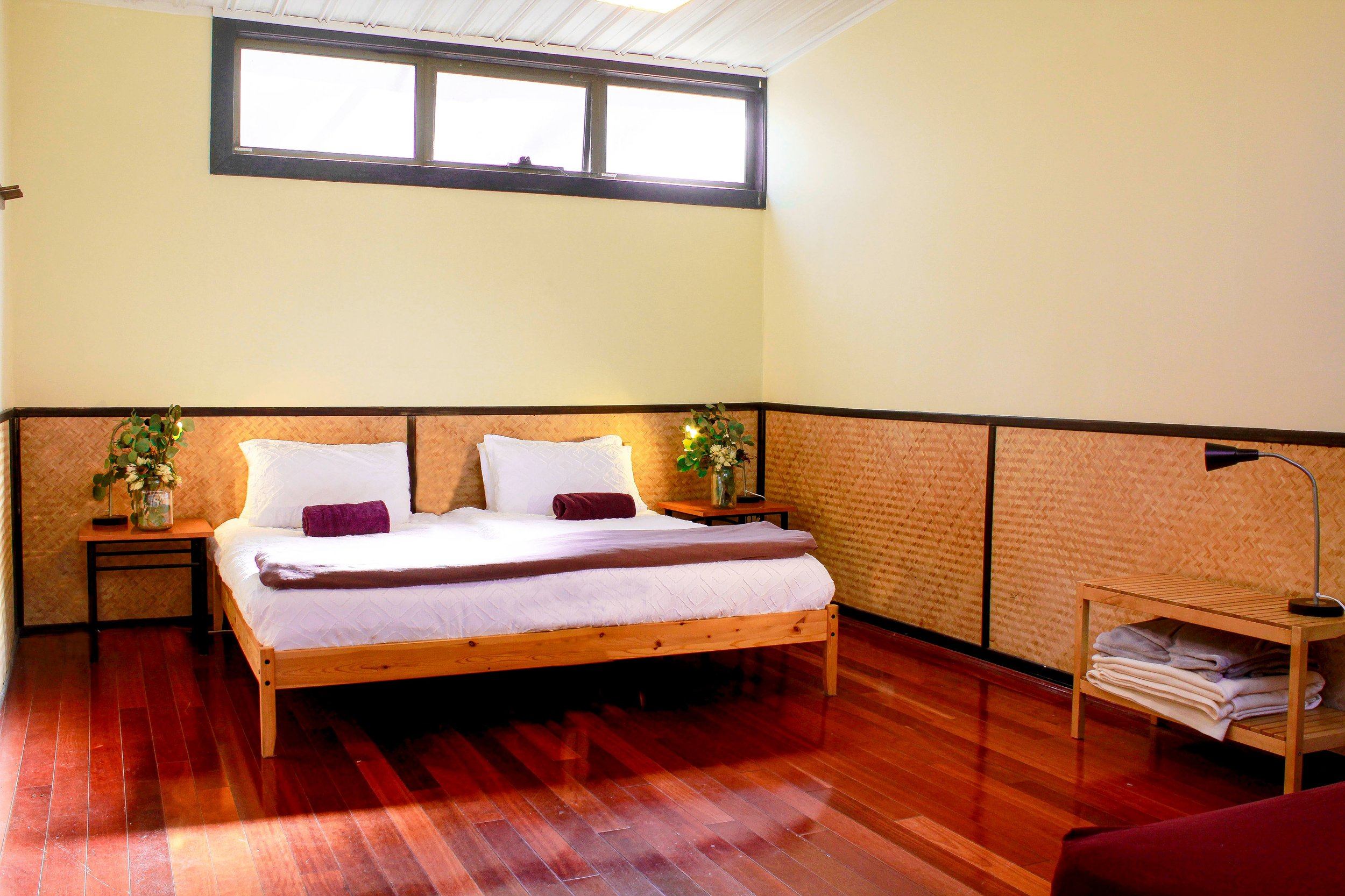 PACKAGE 3 - QUEEN + SINGLE W/SHARED FACILITIES Features: Queen Size Bed + Single bed, communal bathrooms, polished wooden floors, fans + heater, free high speed WiFi, free parking. Incl. yoga classes + 3 vegan meals daily + workshops.
