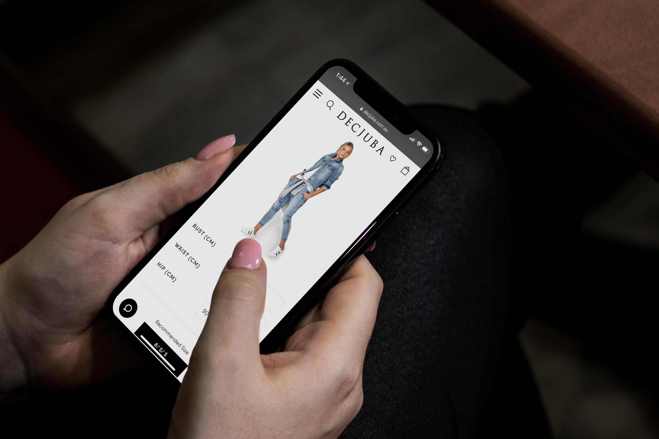 Woman_using_black_iPhone_X_mockup.png