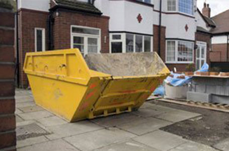 Drop door skips - Why not make things easier for yourself and book a drop door skip at no extra cost? One end of the skip opens fully to allow you direct access into the skip. This is especially helpful when loading things like hardcore and soil or other heavy items. Drop doors are available on 6yd and 8yd skips.