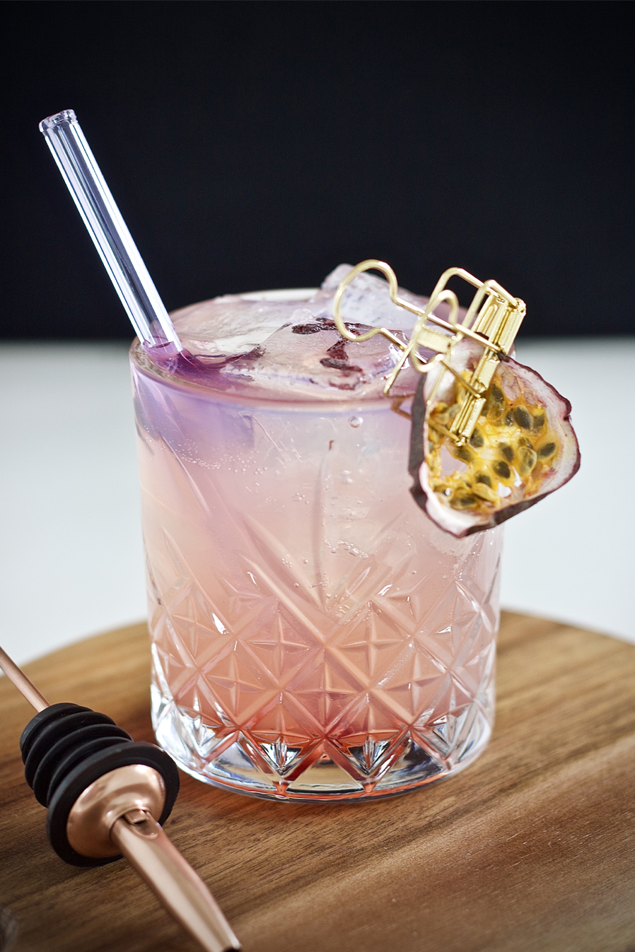 Passionate Elixir - Summer inspired cocktail. Way to change things up!6cl Illusionist Dry Gin1.5cl Freshly squeezed lemon juice1.5cl Raspberry & Rose Syrup2 Dashes Lavender BittersTop with Peach Tonic WaterGarnish - Rose petal infused ice and a dehydrated passion fruit slice