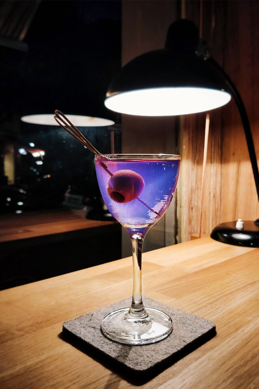 Blue Martini - Fabelei Bar meets Illusionist Dry Gin in a perfect marriage of creativity and attention to detail.6cl Illusionist Gin 2cl Dolin Dry Vermouth 1cl Cocchi Americano 1 Dash of Celery BittersGarnish - Olive on a skewer