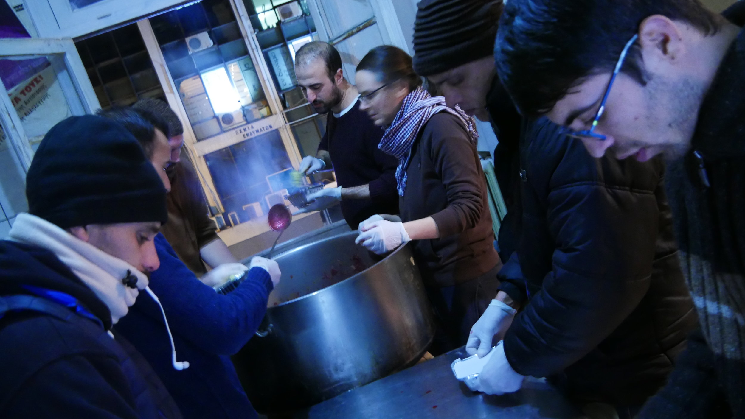 Refugee centre: Preparing food for the distribution at the Afghani-Pakistani camp