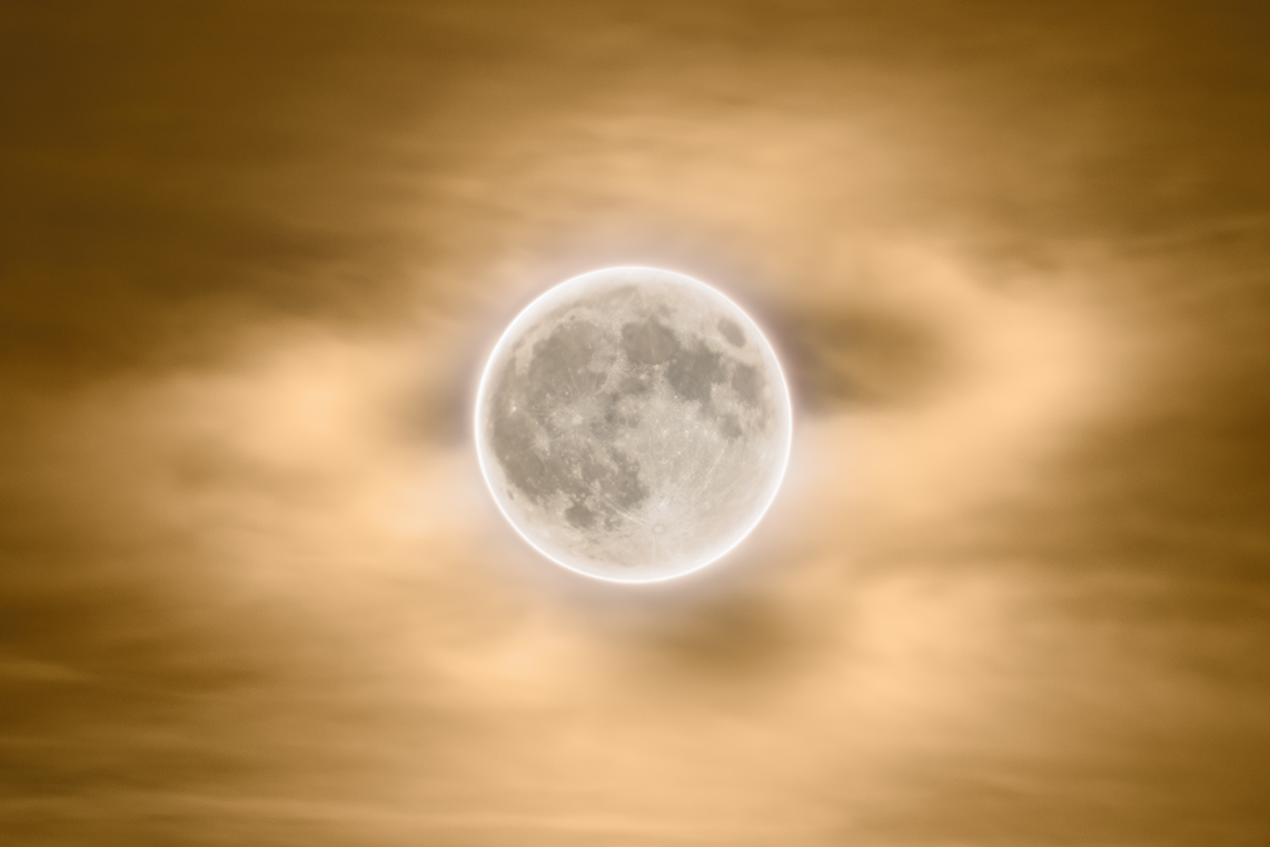 A double exposure of the Full Moon. In this case, the longer exposure also revealed foreground cloud details