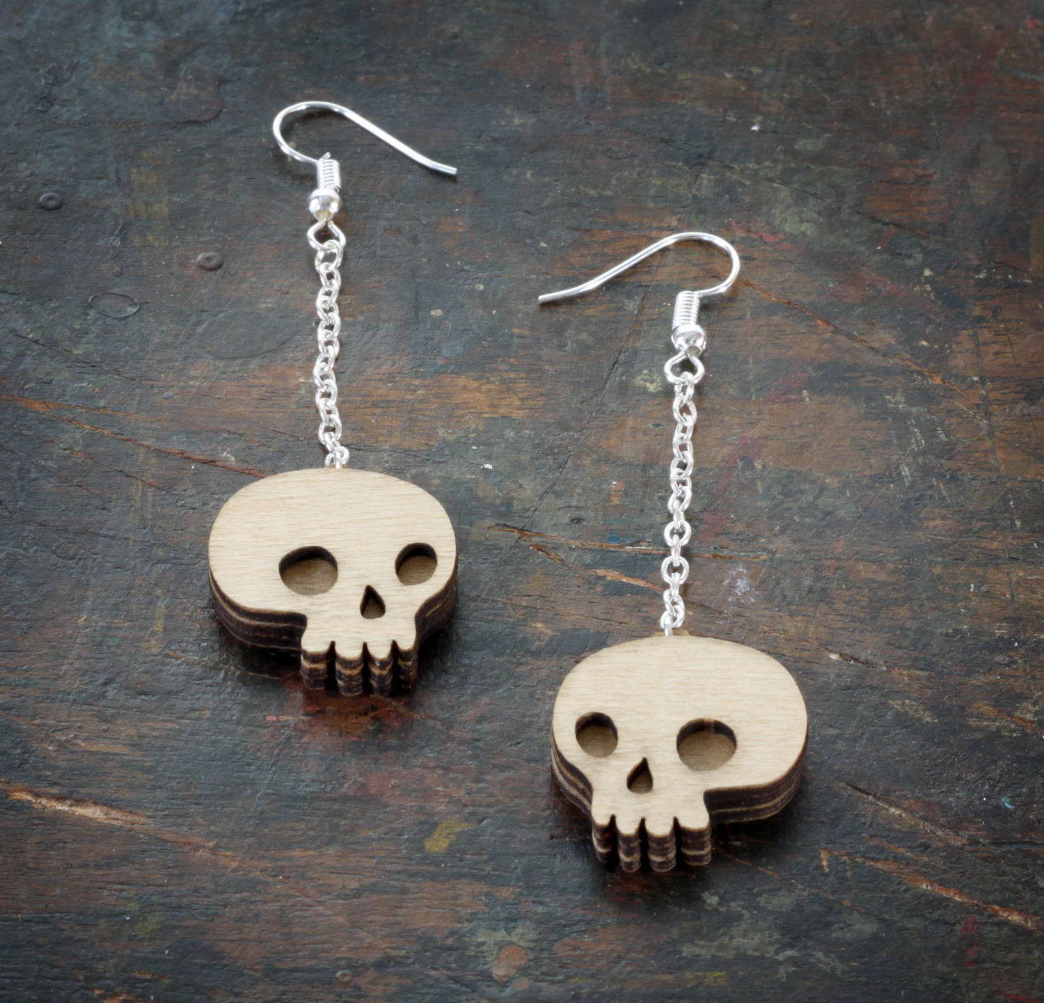 Skull Earrings Desk.jpg