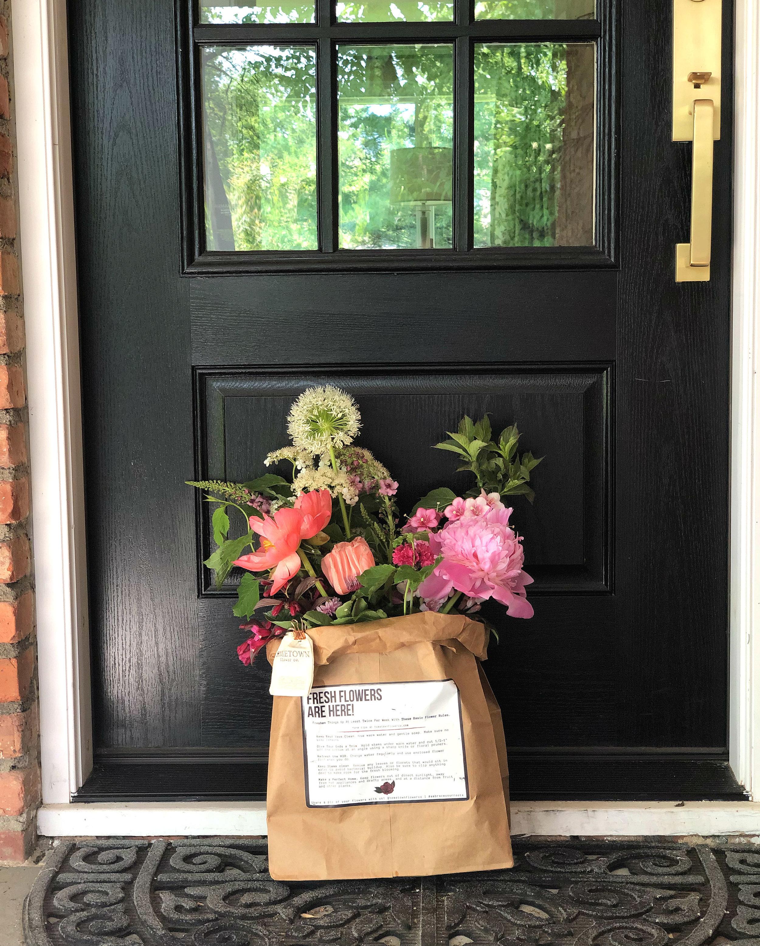 flowersinabag on doorstep.jpg
