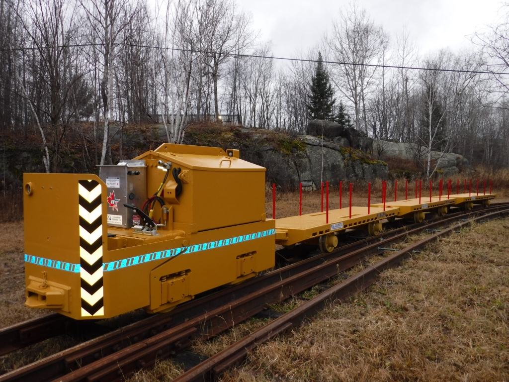 Warren rebuilt locomotive and new flat cars