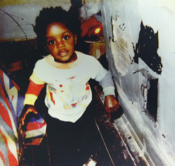 Freddie Gray as a child. Note the peeling paint on the wall to the right.  Family photo from court filing
