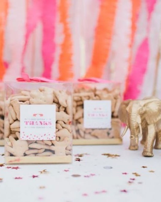 15 Ways to Bring the State Fair to Your Backyard - Animal Cracker Favors: Re-package a stable full of animal crackers into clear boxes adorned with ribbon and a gift tag for a no-stress favor.(image: Somewhere Splendid)