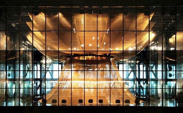 The golden veil of the European Court of Justice in Luxembourg is the structural highlight of this grand courtroom. A translucent suspended ceiling' (from GKD Metal Fabrics), with a golden shimmer formed from 40 trapezoid-shaped bronze anodized Escale fabric panels, creates a contemporary interpretation of the classic dome.   #architecture #architect #european #exteriordesign #design #construction #facade #fabrication