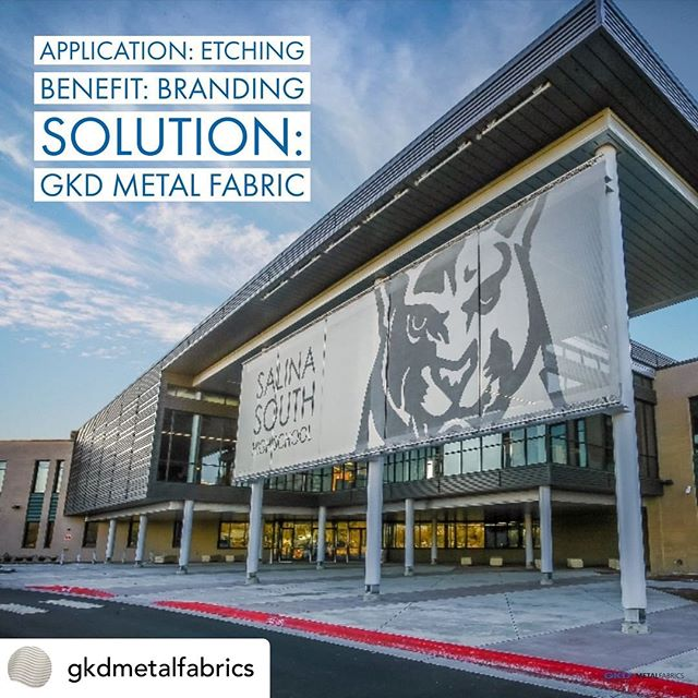 Posted @withrepost • @gkdmetalfabrics Etching is a specialized technique that can help brand a building, communicate a key message or show school spirit. Graphics are mechanically etched onto the metal fabric surface to create a durable contrasted image. . . . . . #etching #sunshading #solar #metalfabric #metalmesh #architecture #design #facade #facadedesign #facadelovers