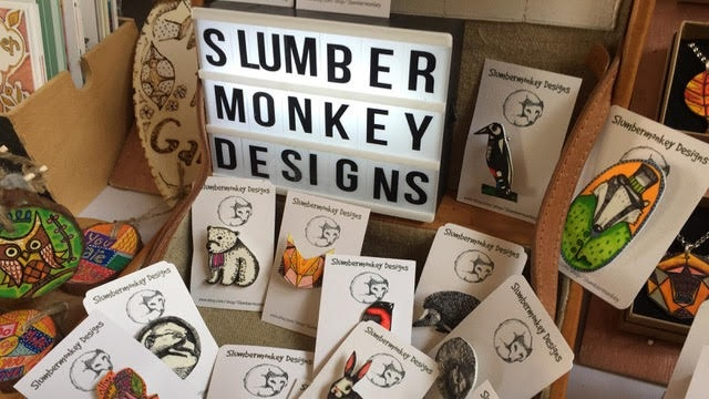 Slumbermonkey Designs - Slumbermonkey Designs is based in North Dorset and sells a range of quirkily illustrated jewellery as well as colourful prints, cards, gift wrap and homewares. Inspiration comes from animals and nature as well as a mid-century aesthetic and often explores the power of words. All designs are original and reflect an individual and playful approach to the world.