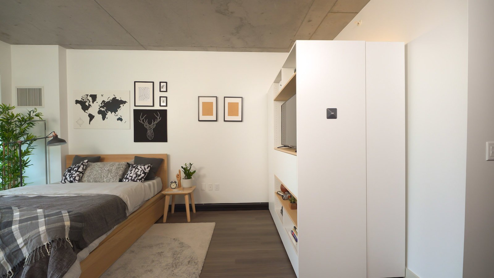 the-pocket-closet-takes-up-the-space-of-two-wardrobes-yet-it-can-serve-as-a-walk-in-closet-desk-entertainment-center-or-dining-bar.jpg