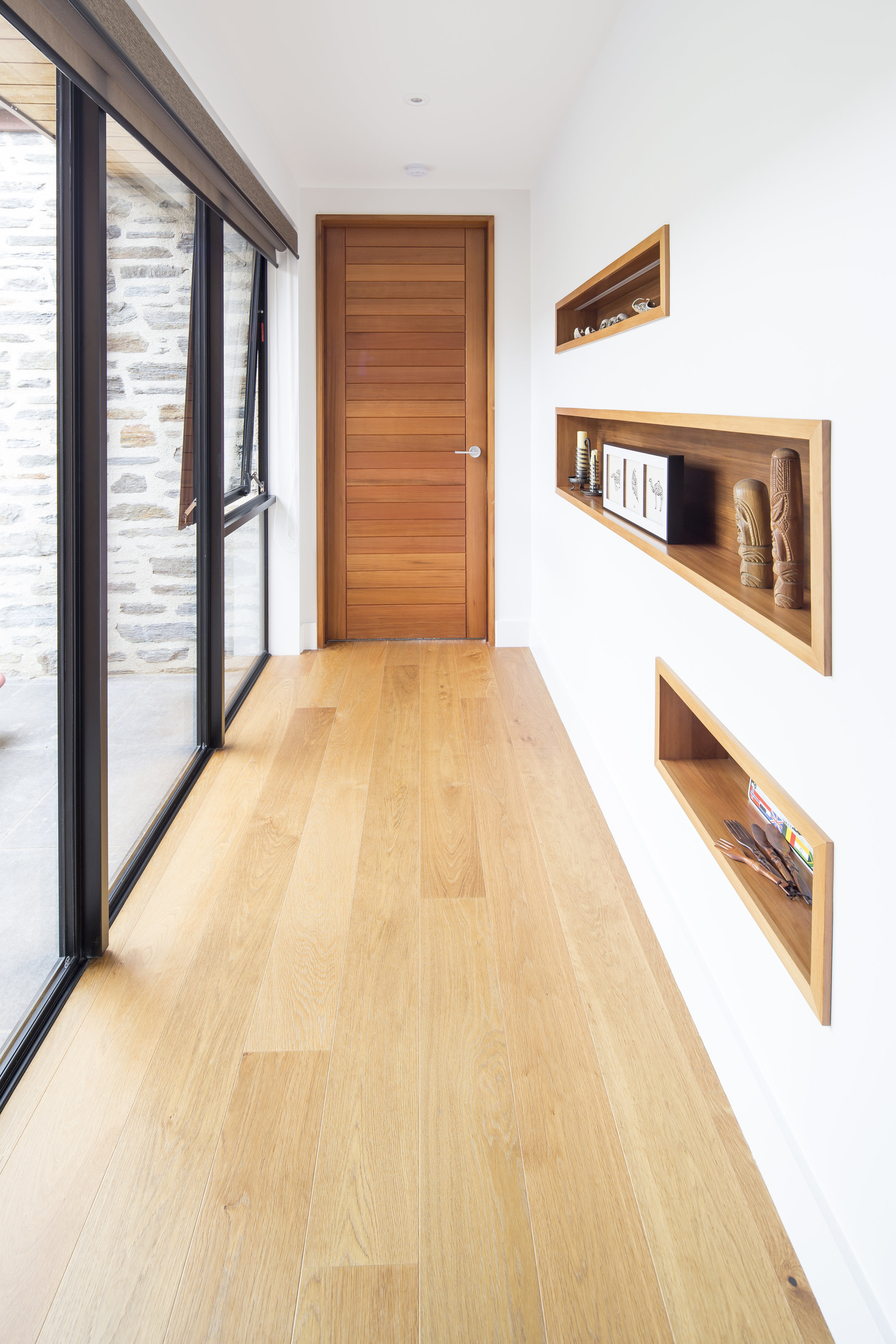 Gorgeous timber recesses feature family treasures