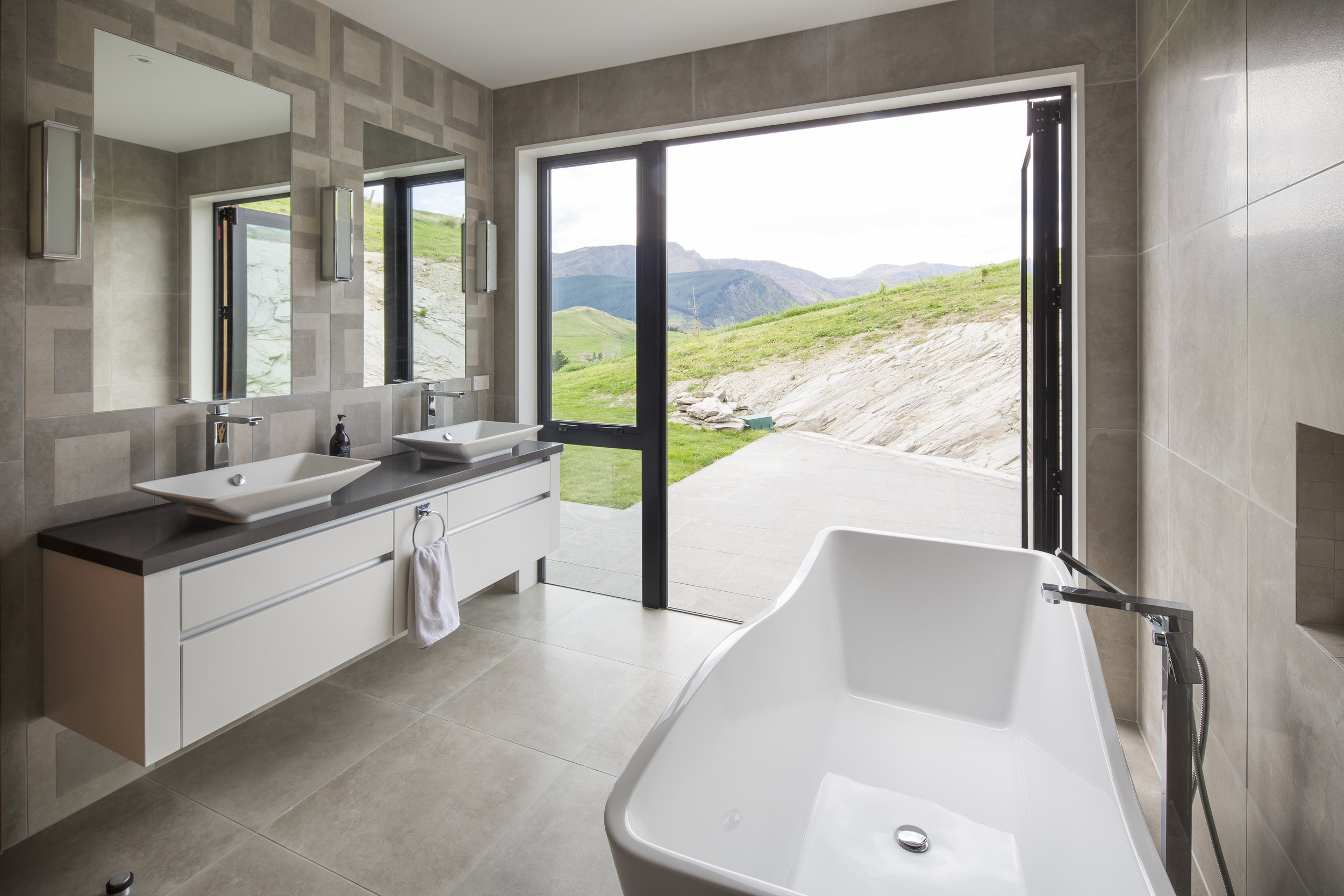 Interior fittings had to complement, not overtake the breath taking views of Coronet Peak and surrounding mountains