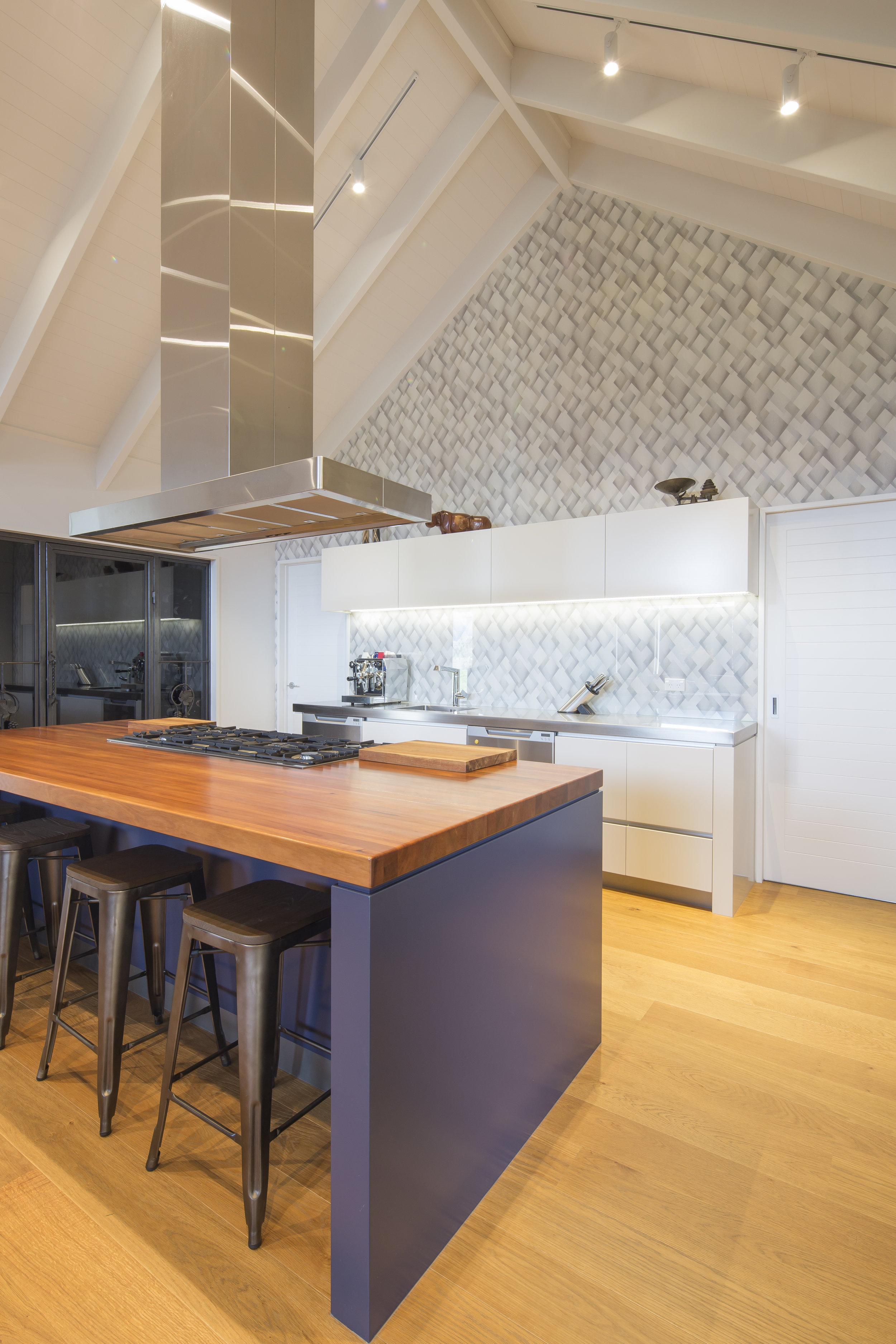 The kitchen's wallpaper complements the views out of the windows