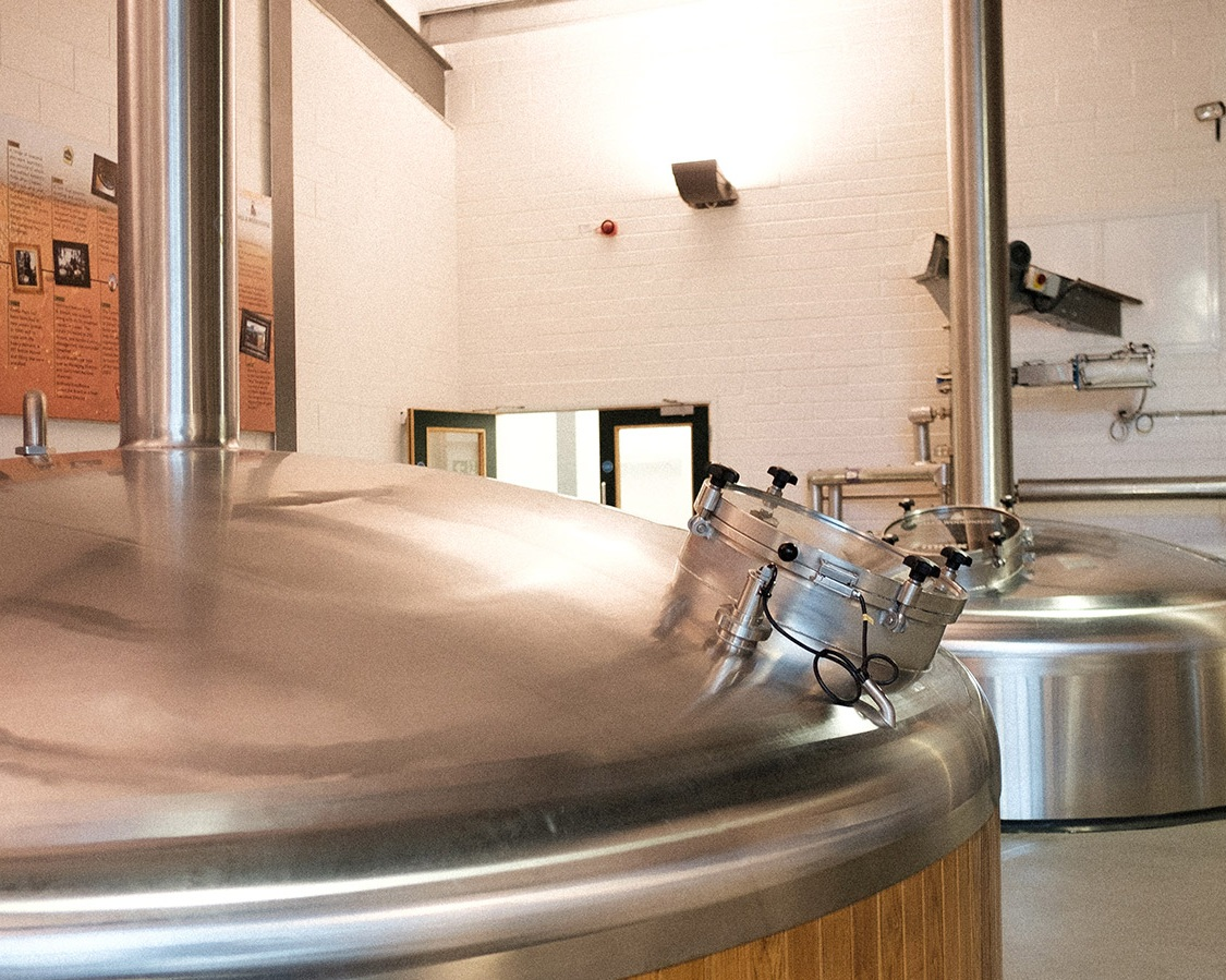Stainless steel fermenting vessels at Hall & Woodhouse brewery