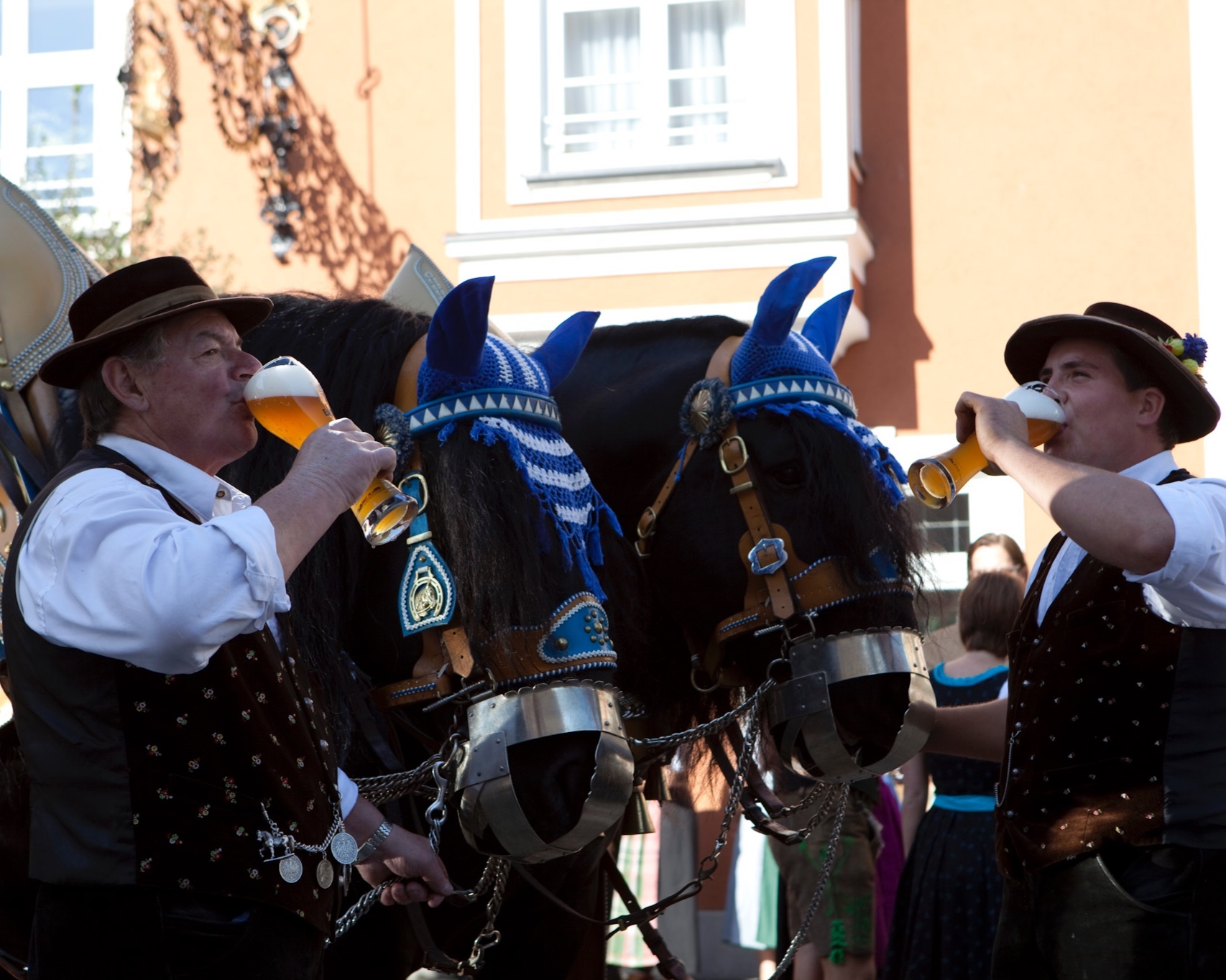 Two carriage drivers drinking Erdinger Weissbier after their delivery
