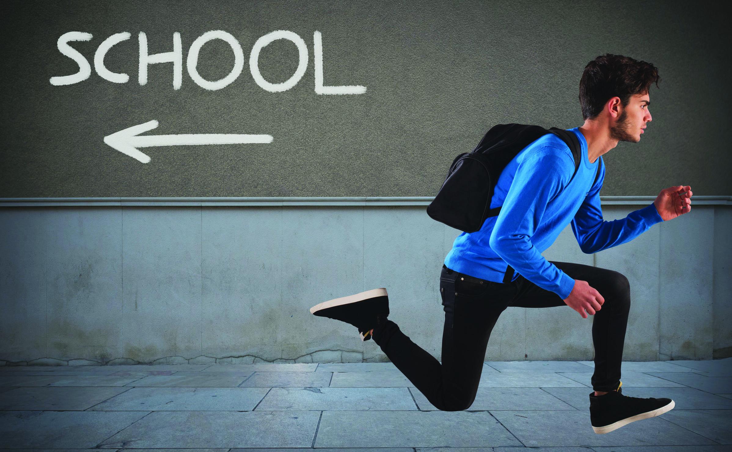 Boy runnning from school.jpg