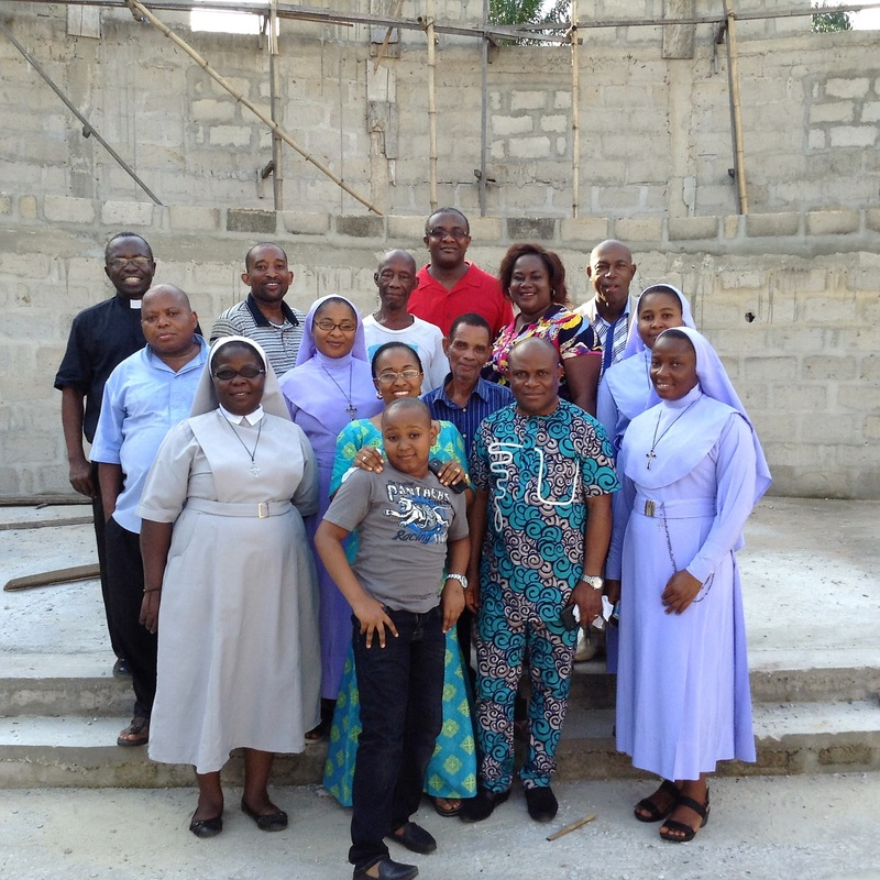 Father Akan Simon (rear, in red) with other Priests, Religious Nuns and the Building Project Team.