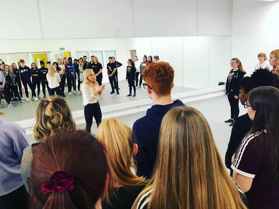 Sophie Isaacs from HEATHERS works with LCPA's West End Bootcamp students