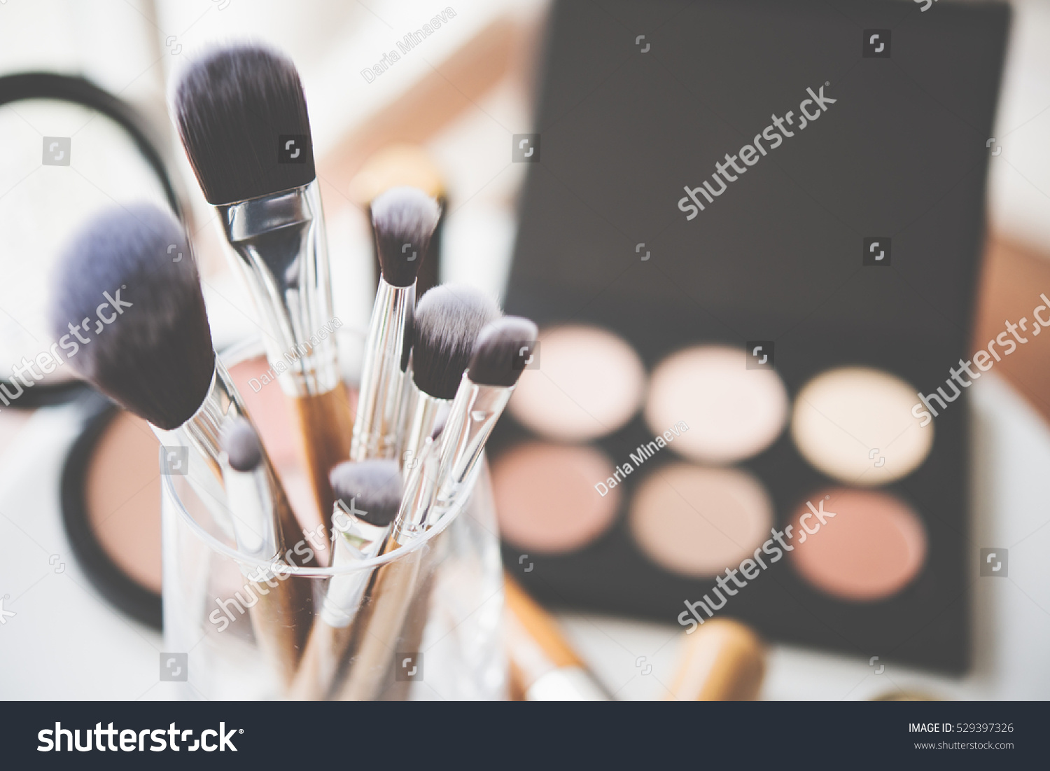 stock-photo-professional-makeup-brushes-and-tools-529397326.jpg