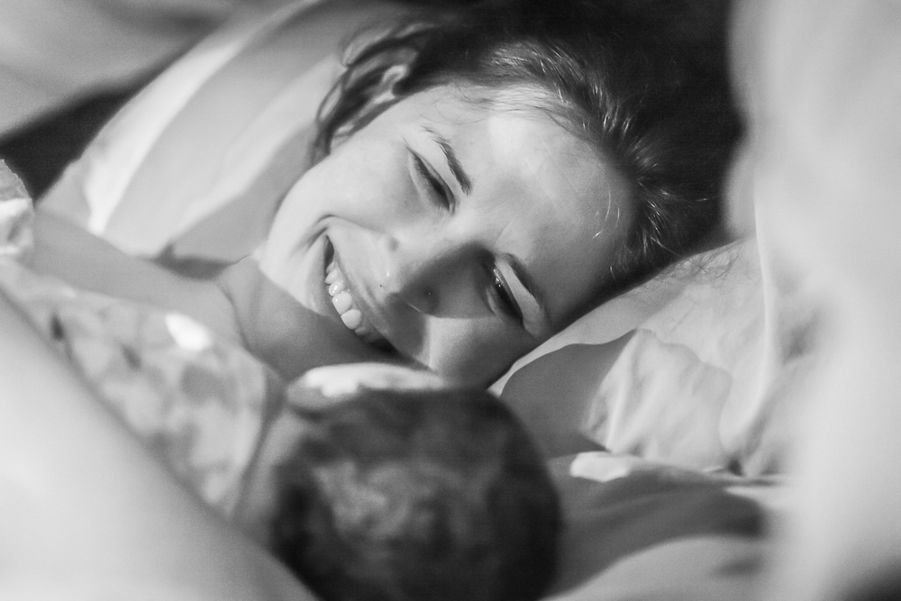 Postpartum and happy. Capturing that moment when Mom meets baby for the very first time.