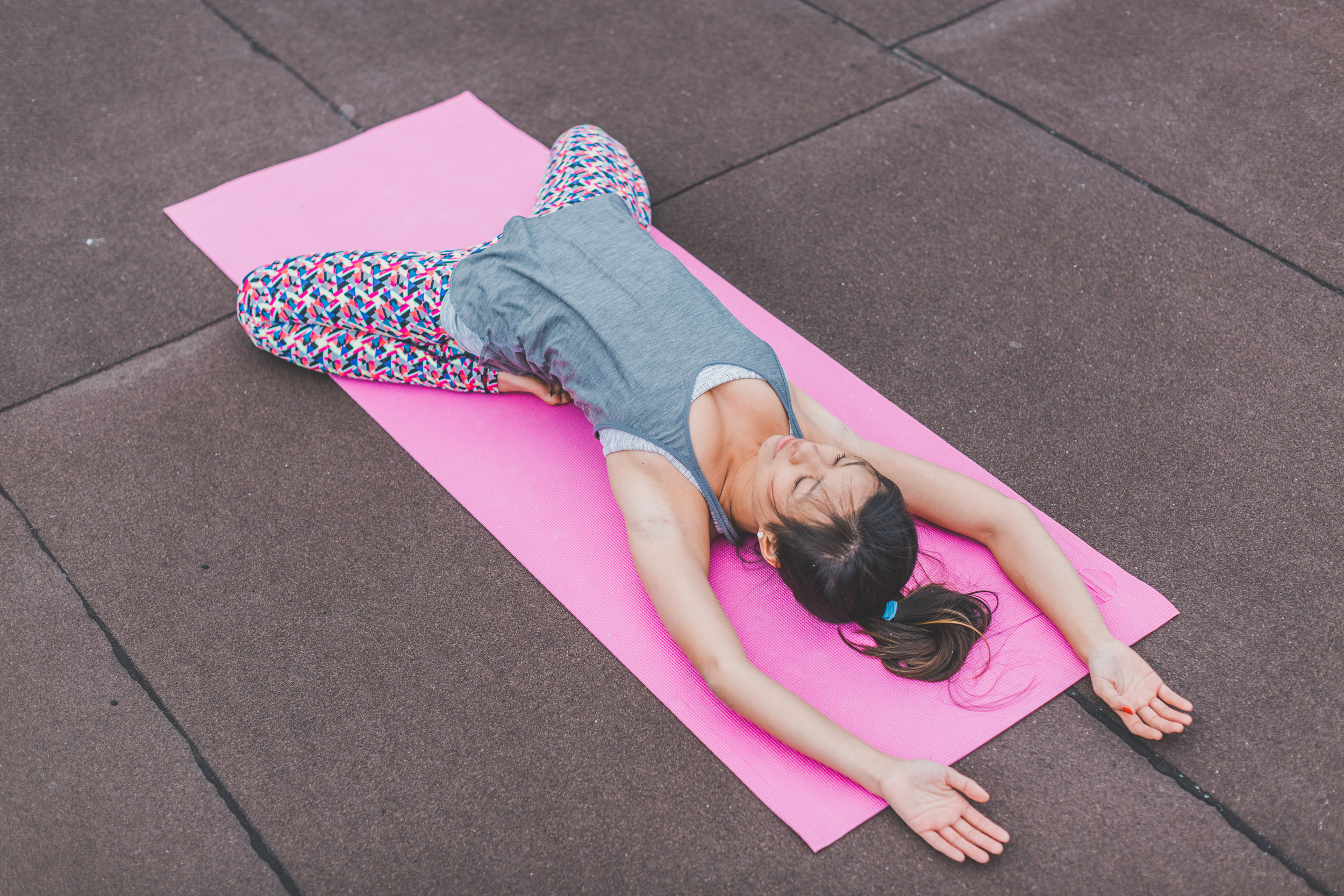 Canva - Woman Lying on Pink Yoga Mat.jpg