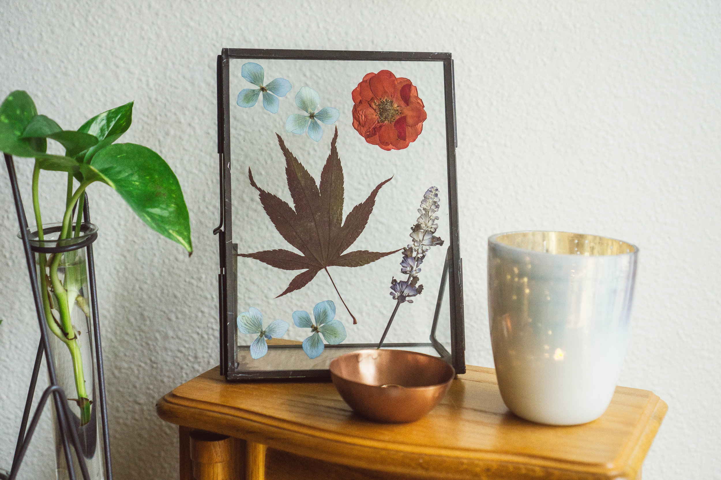 Dried flowers and leaves in metal frame from Foragedhome.com