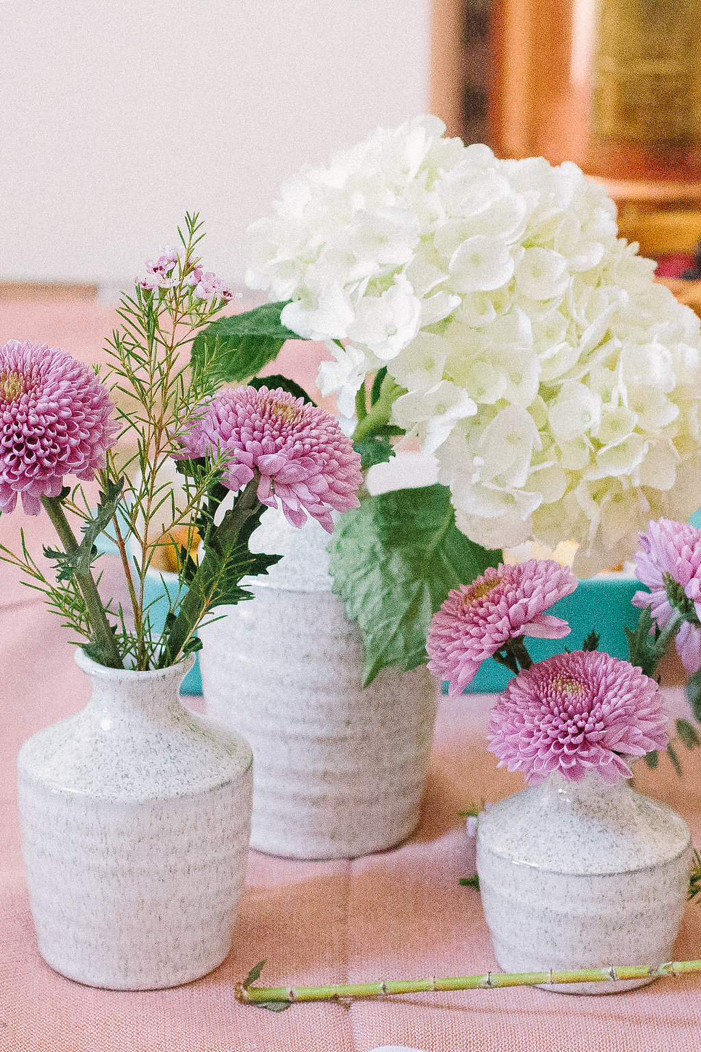 white ceramic bud vases with fresh flowers foraged home