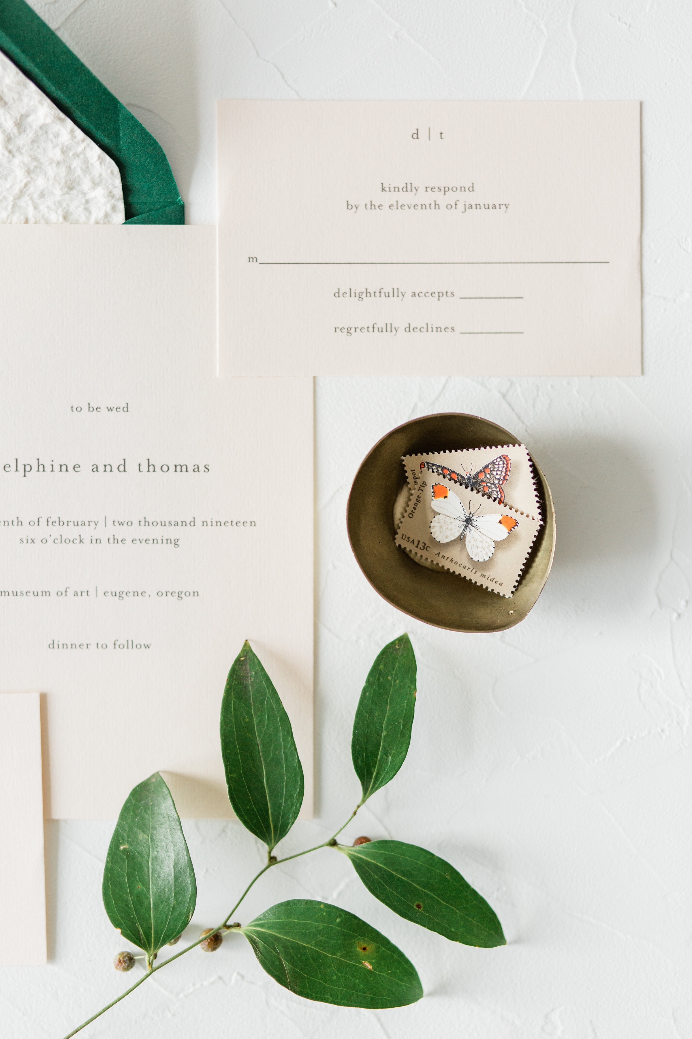 wedding invite styling with brass accents